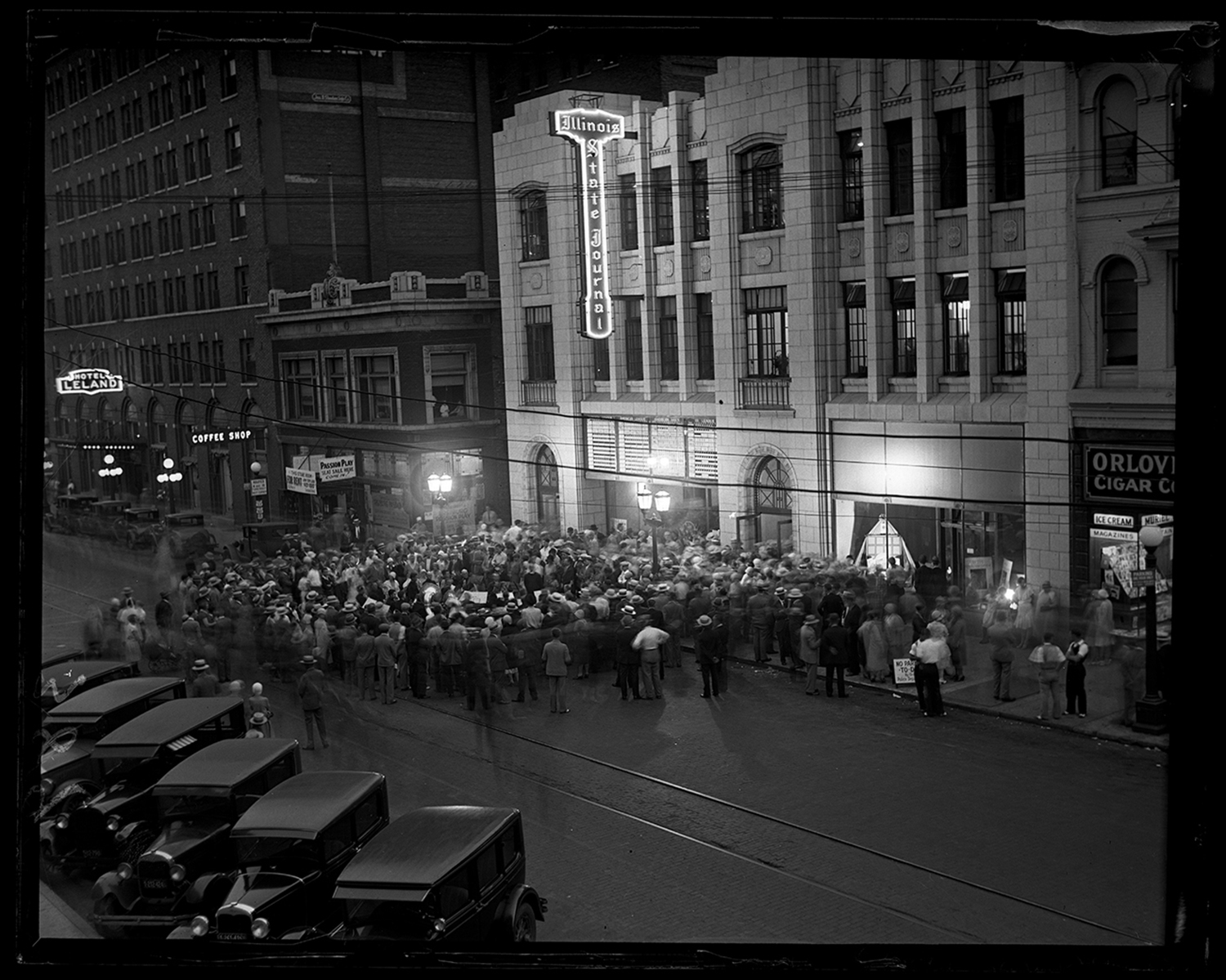 A band entertains people waiting to tour the new Illinois State Journal building, June 18, 1930. The tours began at 7 p.m. and lasted into the evening so visitors could see as much of the production as possible. Sixth Street in front of the building was closed to traffic to accommodate the crowds. Col. Ira C. Copley, who had purchased the Journal two years earlier, greeted the visitors. File/The State Journal-Register