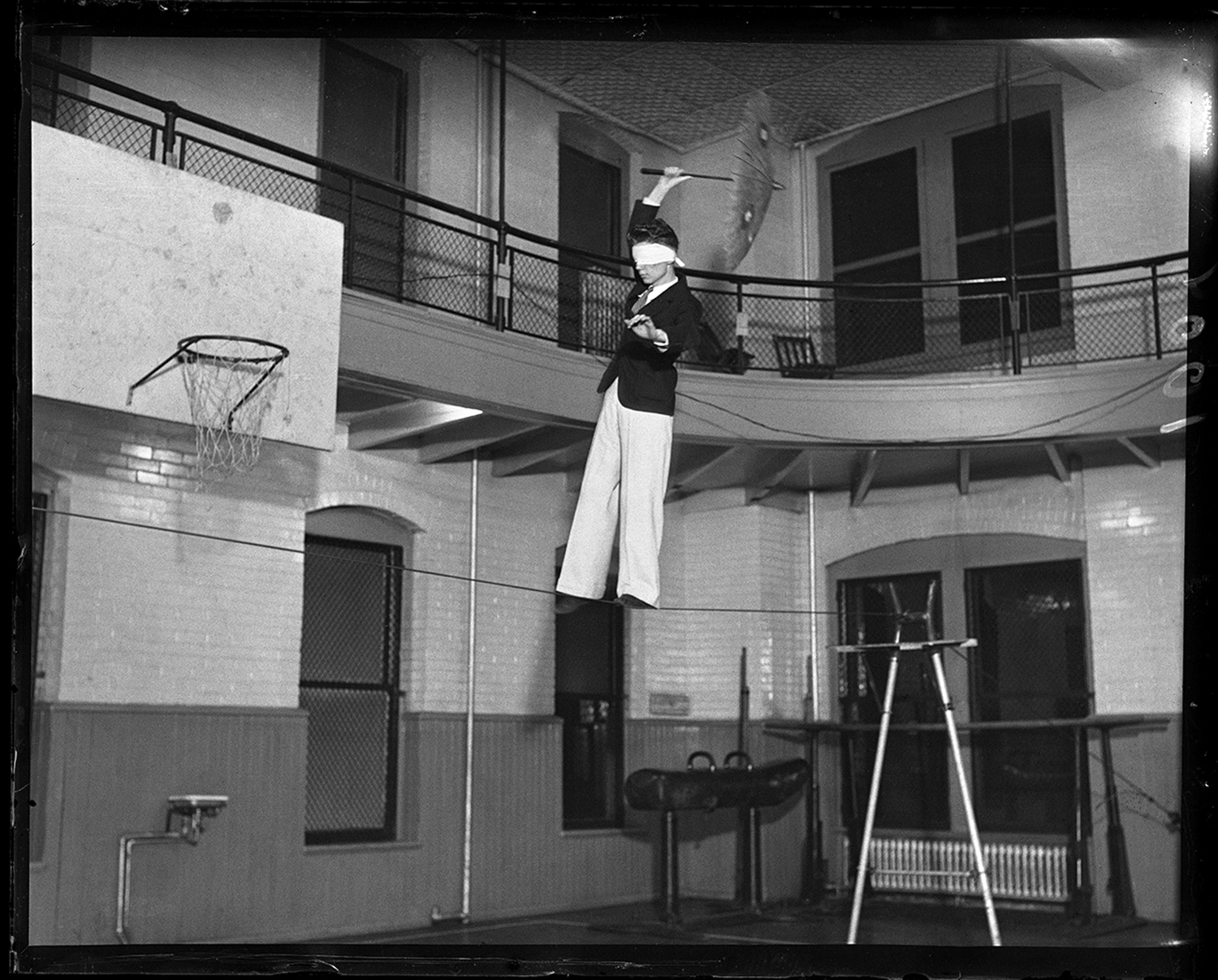 """Joe Imlay, instructor and tight wire enthusiast at the Y.M.C.A, practices for the """"Y"""" Circus at the Illinois State Arsenal, circa 1931. File/The State Journal-Register"""