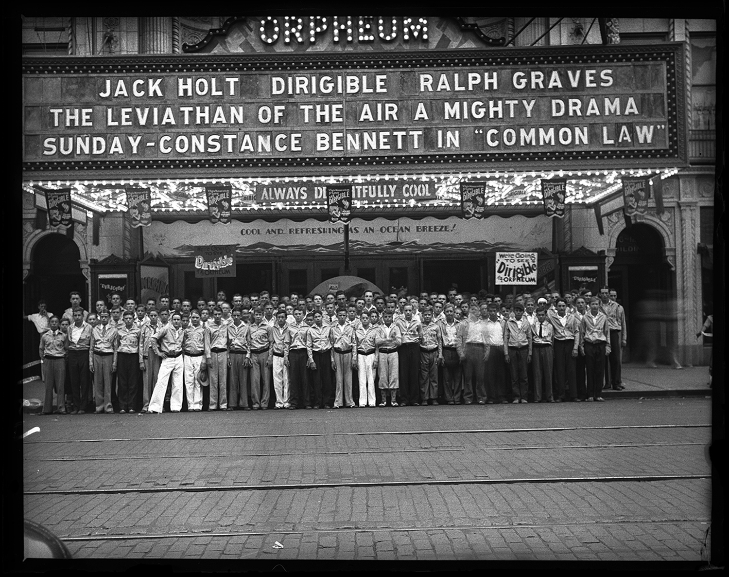 """Group photo of Illinois State Journal news carriers (""""Carrier Boys Enjoy Movie"""") at the Orpheum Theater, Aug. 20, 1931. File/The State Journal-Register"""