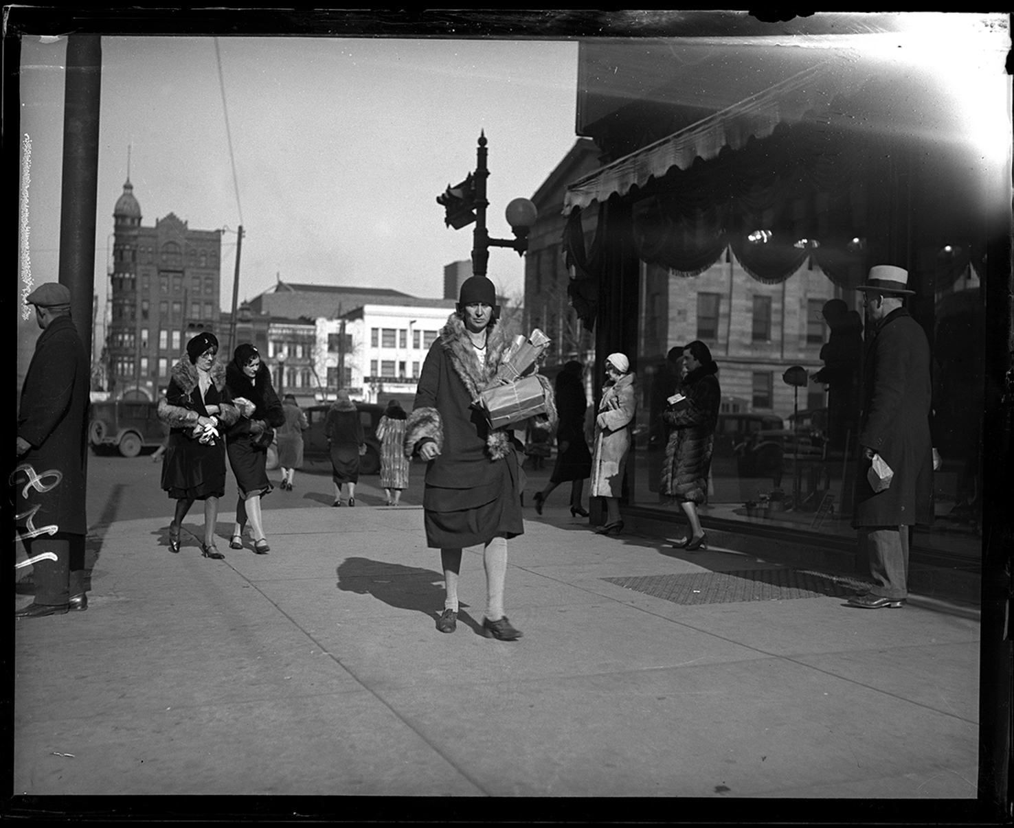 Pedestrians on Fifth Street at Adams, facing north, public square in background, Dec. 18, 1930. File/The State Journal-Register