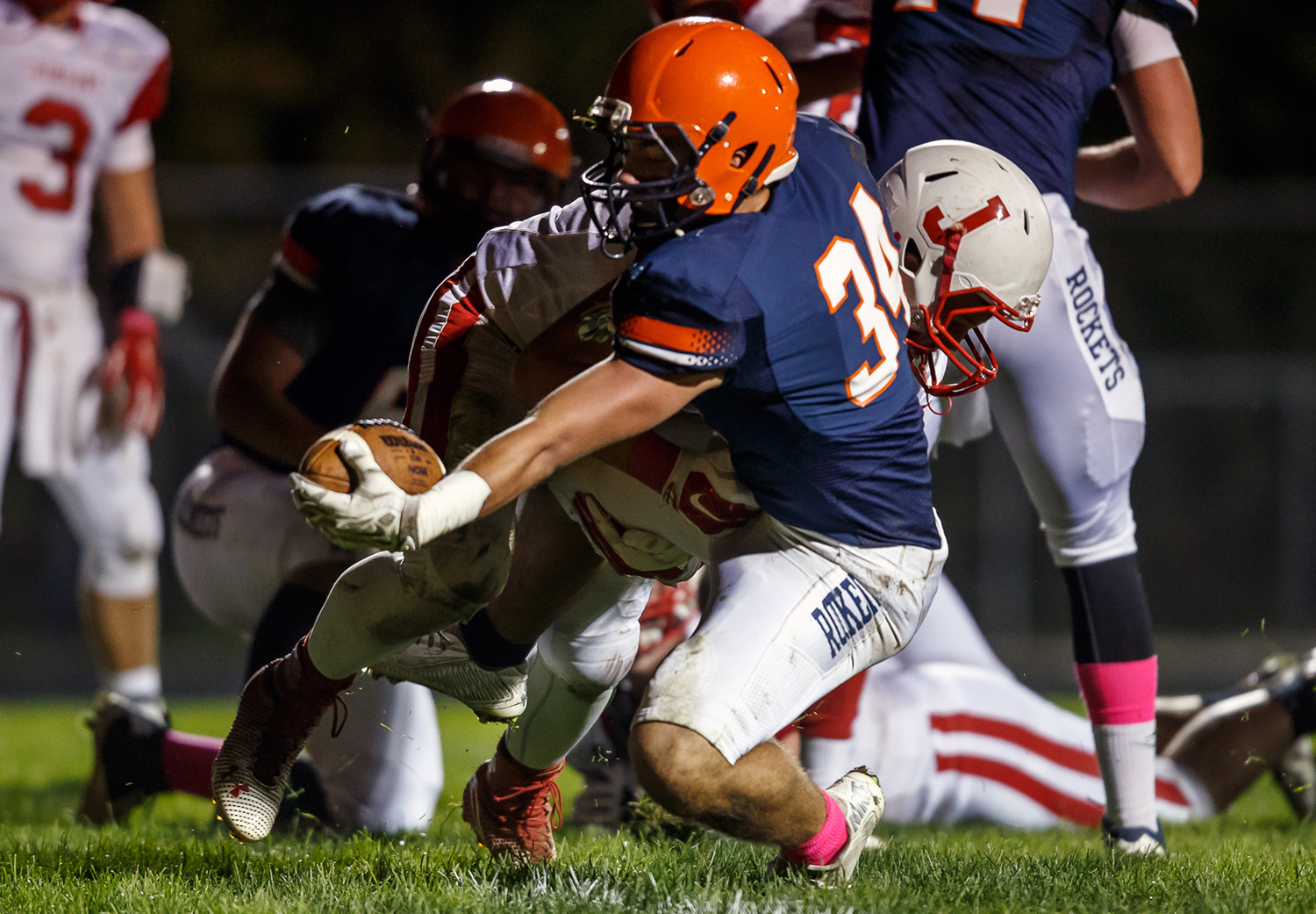 Rochester's Evan Sembell (34) puts the ball over the goal line for a touchdown against Jacksonville during the first half at Rocket Booster Field, Friday, Oct. 10, 2014, in Rochester, Ill. Justin L. Fowler/The State Journal-Register