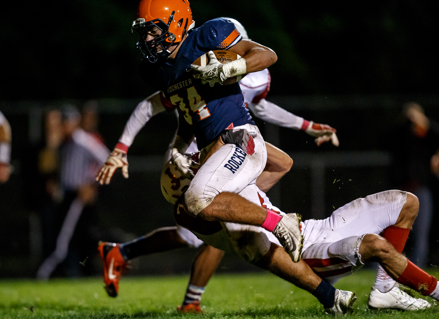 Rochester's Evan Sembell (34) breaks a tackle from Jacksonville's Walt Miller (7) for a touchdown during the first half at Rocket Booster Field, Friday, Oct. 10, 2014, in Rochester, Ill. Justin L. Fowler/The State Journal-Register