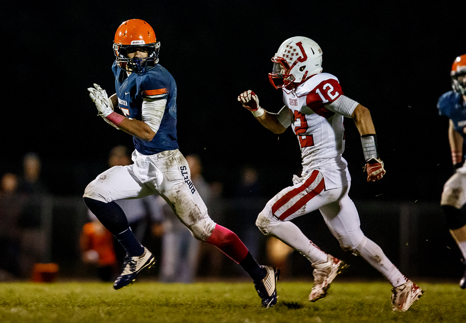 Rochester's Jeremy Bivens (15) breaks away from Jacksonville's C.J. Wright (12) on his way to a 73-yard touchdown during the second half at Rocket Booster Field, Friday, Oct. 10, 2014, in Rochester, Ill. Justin L. Fowler/The State Journal-Register