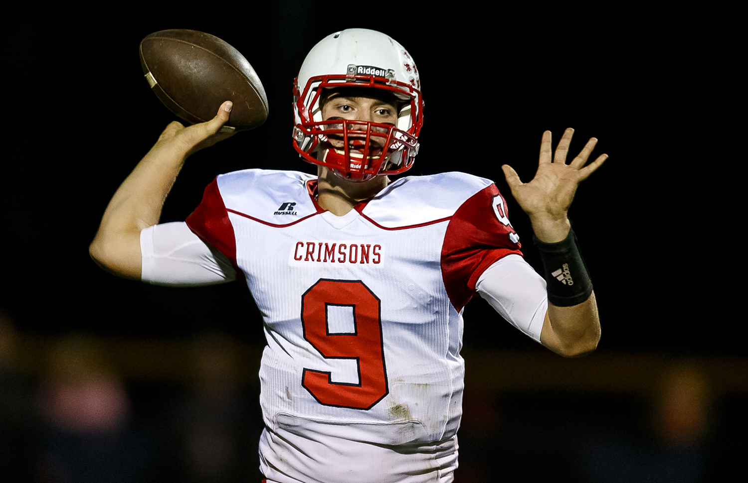 Jacksonville's Joe Brannan (9) launches a pass against Rochester during the second half at Rocket Booster Field, Friday, Oct. 10, 2014, in Rochester, Ill. Justin L. Fowler/The State Journal-Register