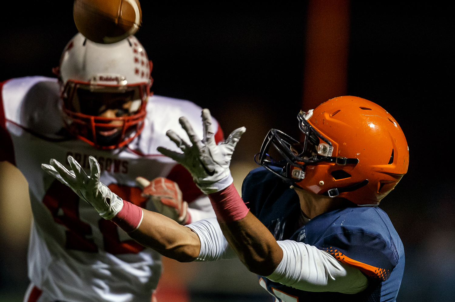 Rochester's Jeremy Bivens (15) lays out for a catch against Jacksonville's Juan Jackson (42) during the first half at Rocket Booster Field, Friday, Oct. 10, 2014, in Rochester, Ill. Justin L. Fowler/The State Journal-Register