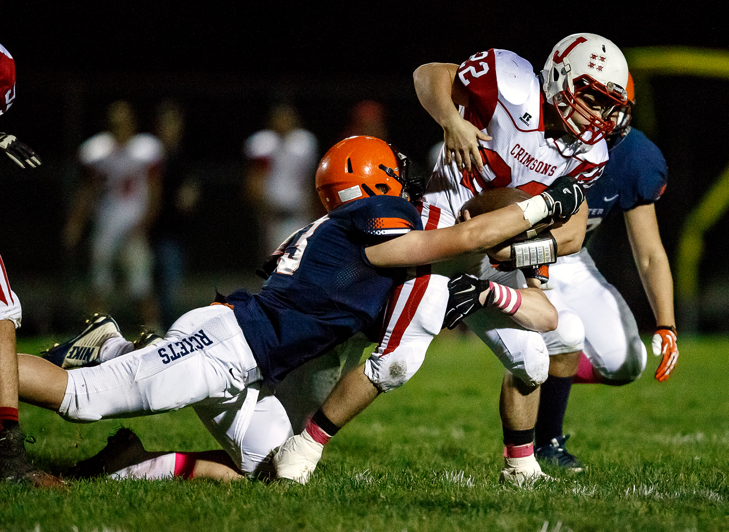Jacksonville's Matt Rooney (22) is brought down by the Rochester defense during the first half at Rocket Booster Field, Friday, Oct. 10, 2014, in Rochester, Ill. Justin L. Fowler/The State Journal-Register