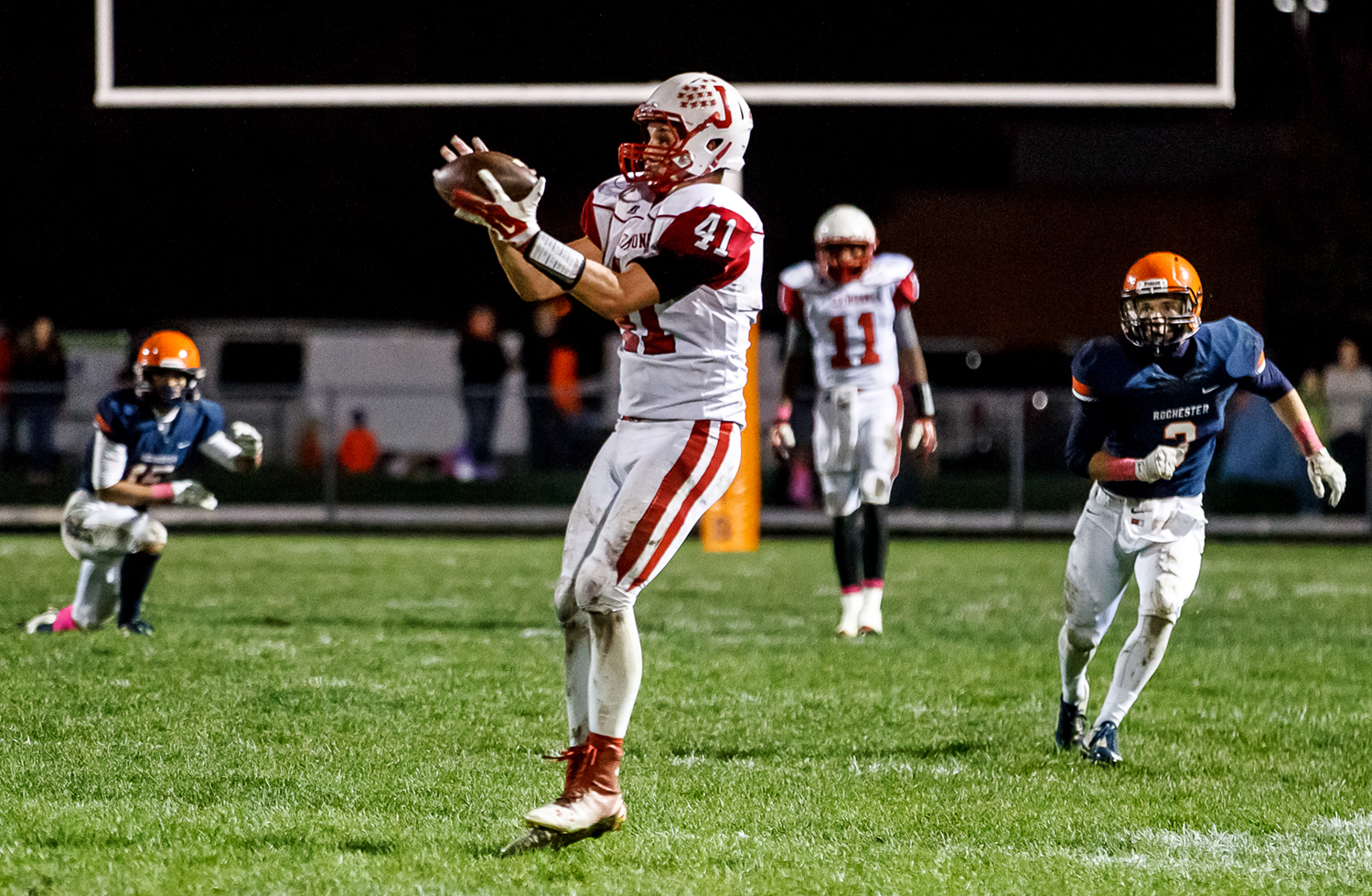 Jacksonville's Adam Hillis (41) pulls in a pass against Rochester during the second half at Rocket Booster Field, Friday, Oct. 10, 2014, in Rochester, Ill. Justin L. Fowler/The State Journal-Register