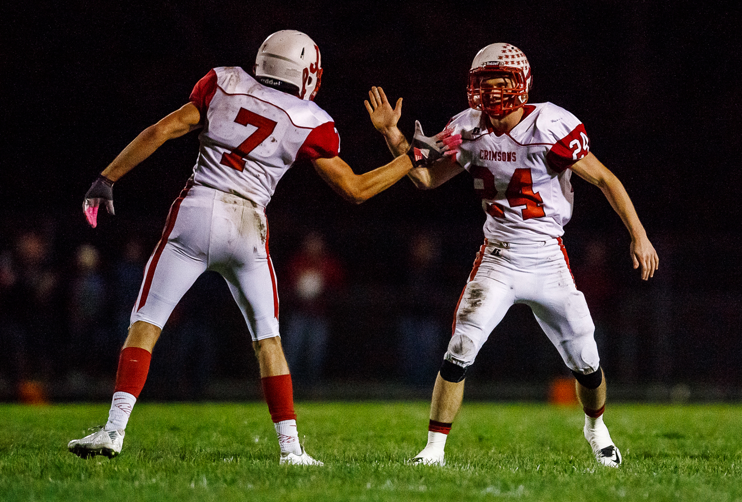 Jacksonville's Dillon Pennell (24) is fired up with Jacksonville's Walt Miller (7) after bringing down Rochester quarterback Danny Zeigler (10) during the first half at Rocket Booster Field, Friday, Oct. 10, 2014, in Rochester, Ill. Justin L. Fowler/The State Journal-Register
