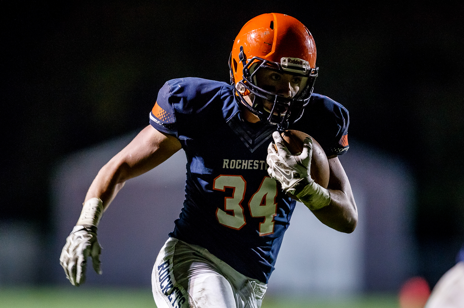Rochester's Evan Sembell (34) takes off on a rush against Jacksonville during the second half at Rocket Booster Field, Friday, Oct. 10, 2014, in Rochester, Ill. Justin L. Fowler/The State Journal-Register