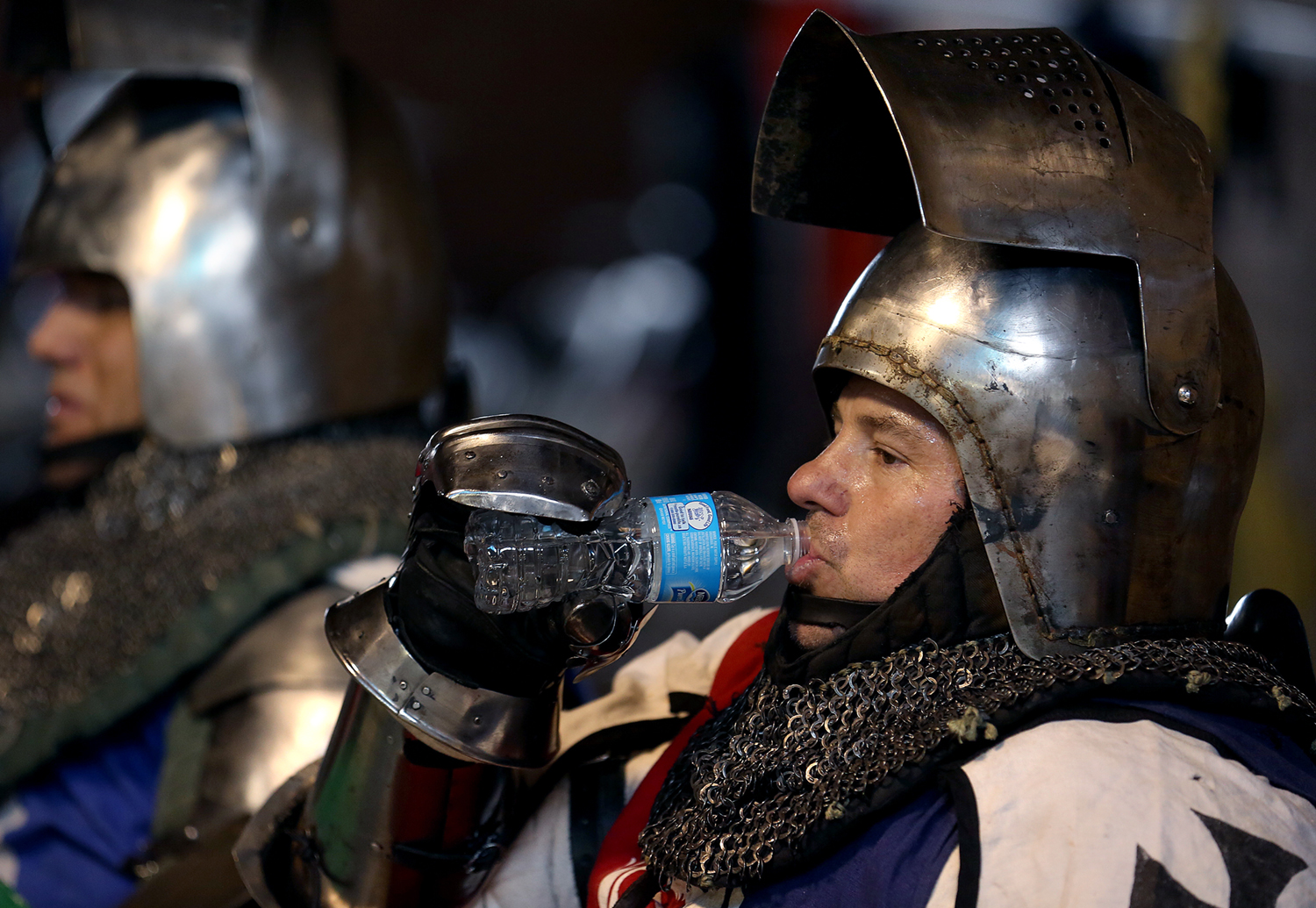 Club Ursus member Steven Schroeder of San Jose, CA takes a water break between bouts Saturday. The Medieval battle competition Battle of the Nations International Tournament of Chivalry took place at the Livestock Center on the Illinois State Fairgrounds in Springfield on Saturday, Oct. 18, 2014. Armored swordfighters competed in the full contact sport individually and as teams from around the world for medals.  David Spencer/The State Journal-Register