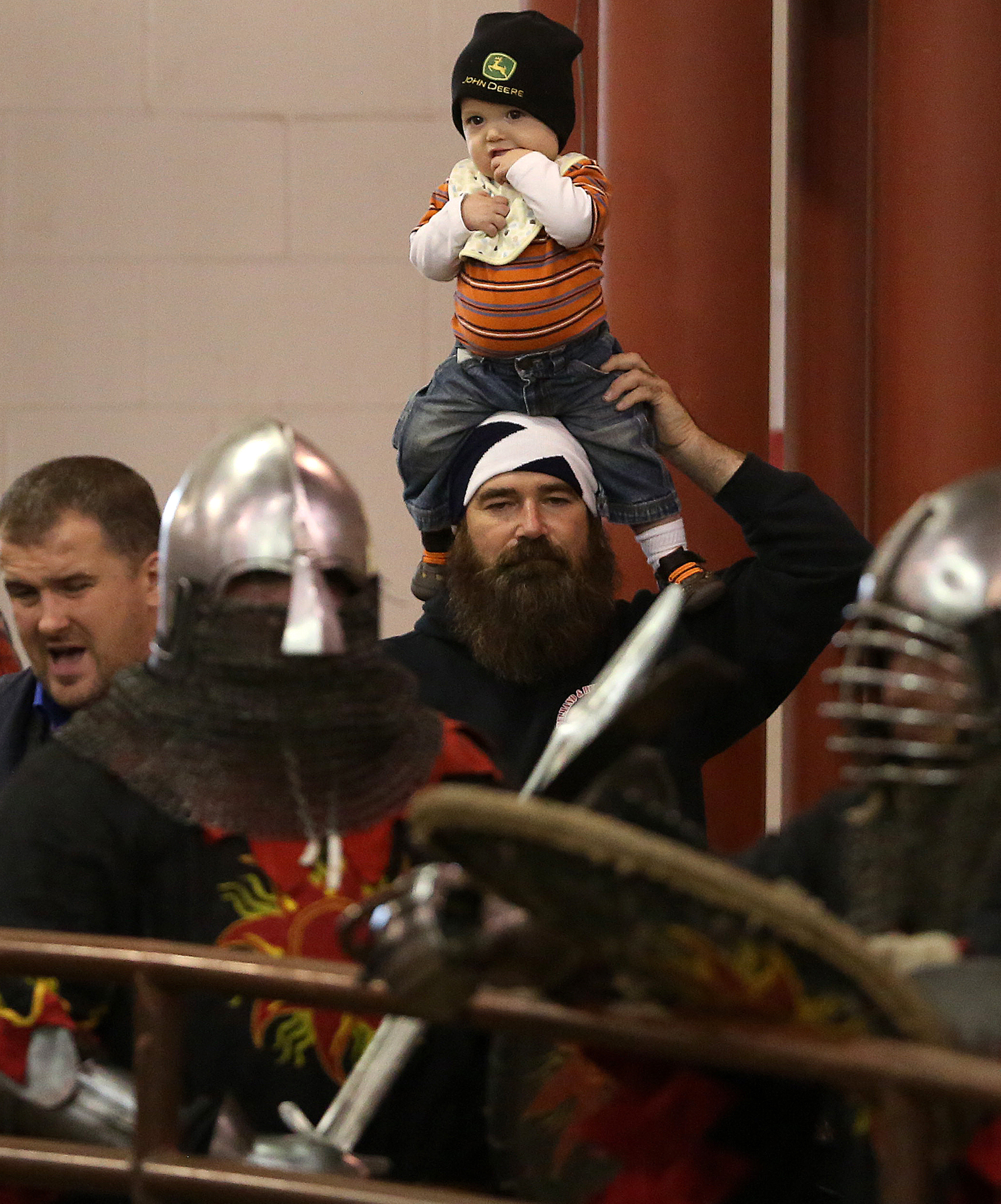 New Berlin resident and Society for Creative Anachronism member Jim Crosier watched the action, along with his grandson Deklan Crosier, outside of the fight ring. The Medieval battle competition Battle of the Nations International Tournament of Chivalry took place at the Livestock Center on the Illinois State Fairgrounds in Springfield on Saturday, Oct. 18, 2014. Armored swordfighters competed in the full contact sport individually and as teams from around the world for medals.  David Spencer/The State Journal-Register