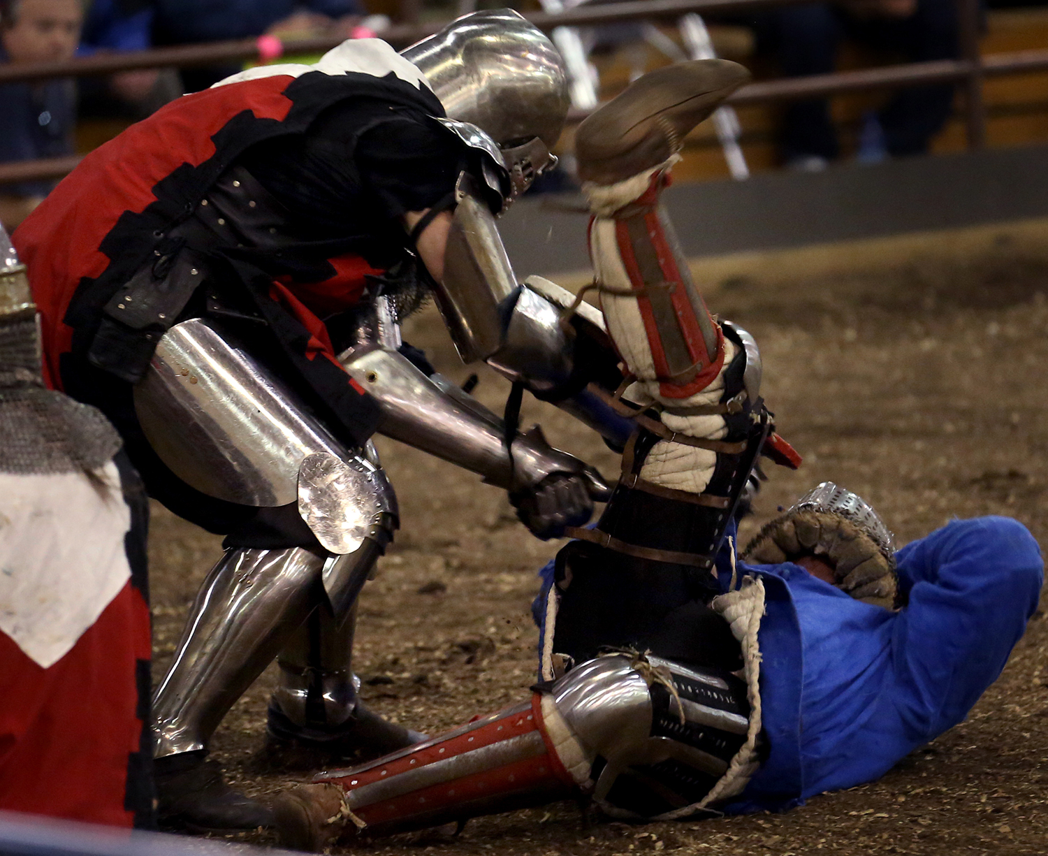 One fighter is knocked down by another on Saturday. The Medieval battle competition Battle of the Nations International Tournament of Chivalry took place at the Livestock Center on the Illinois State Fairgrounds in Springfield on Saturday, Oct. 18, 2014. Armored sword fighters competed in the full contact sport individually and as teams from around the world for medals. David Spencer/The State Journal-Register