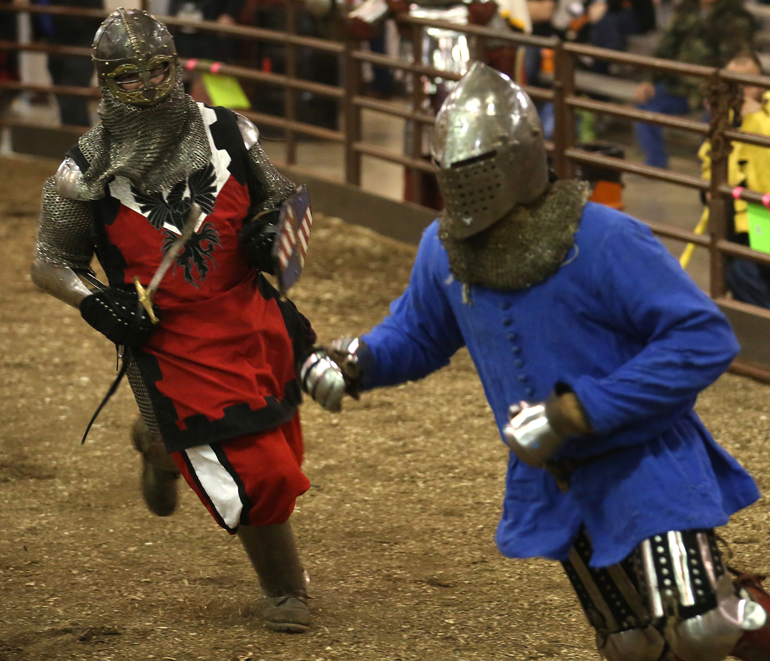 A fighter from Team Syabri Belarus who lost his weapon is chased by an opponent from the Company of the Iron Phoenix. The Medieval battle competition Battle of the Nations International Tournament of Chivalry took place at the Livestock Center on the Illinois State Fairgrounds in Springfield on Saturday, Oct. 18, 2014. Armored sword fighters competed in the full contact sport individually and as teams from around the world for medals. David Spencer/The State Journal-Register