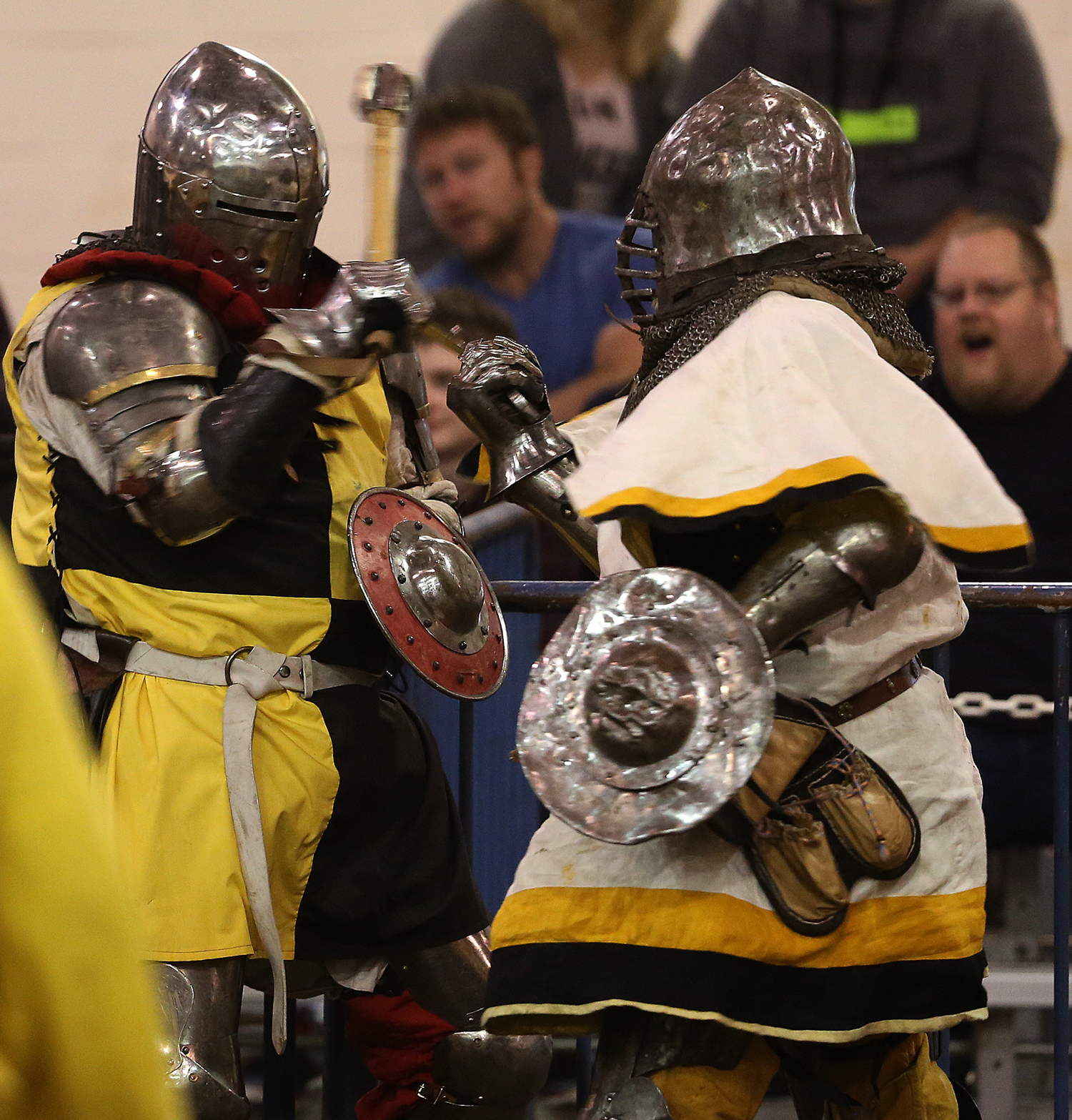 Fighters hold small steel shields while going head to head in battle Saturday. The Medieval battle competition Battle of the Nations International Tournament of Chivalry took place at the Livestock Center on the Illinois State Fairgrounds in Springfield on Saturday, Oct. 18, 2014. Armored sword fighters competed in the full contact sport individually and as teams from around the world for medals. David Spencer/The State Journal-Register
