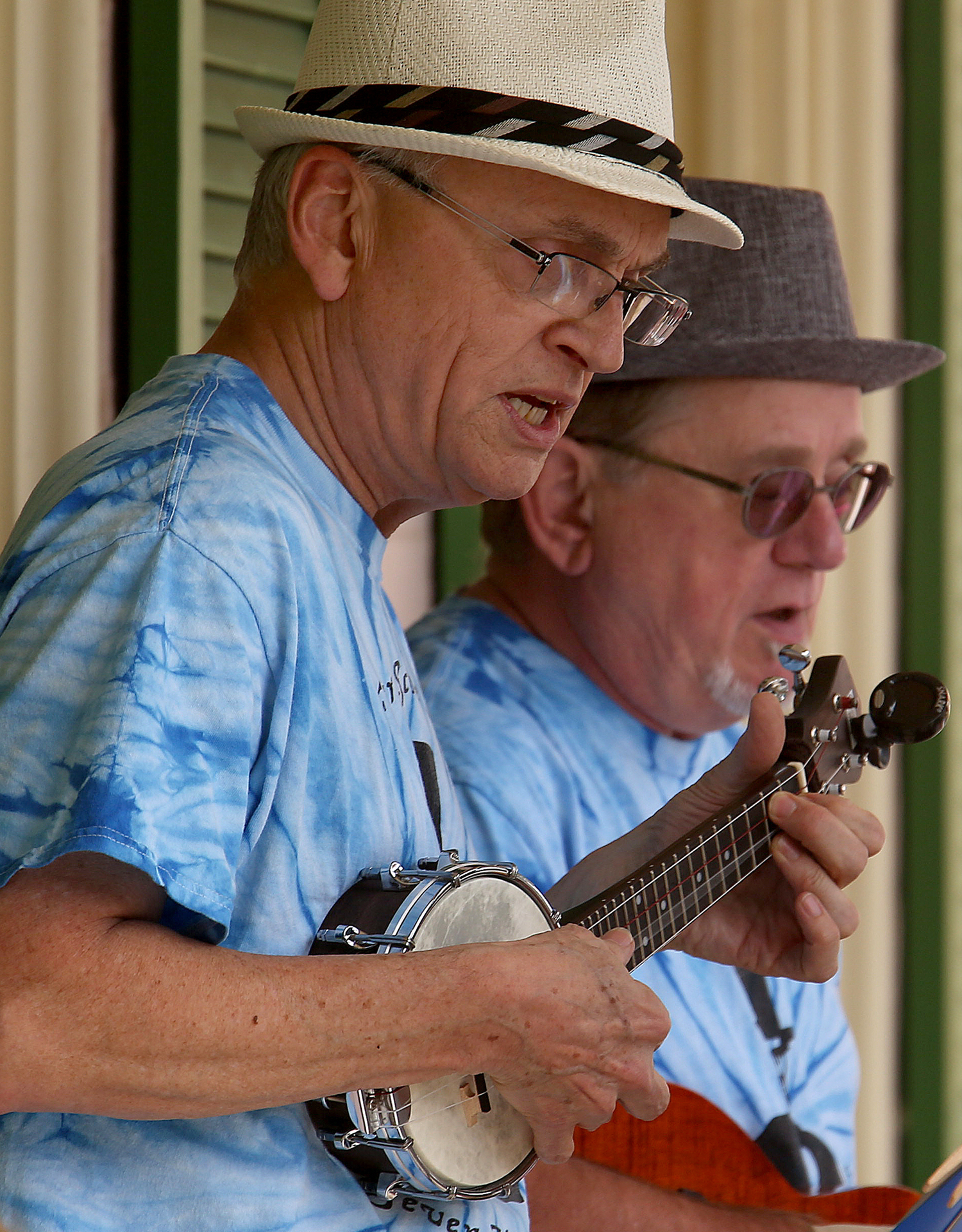 Steve Beilstein of Springfield plays his banjolele- a banjo ukulele, during the Ukutopians performance on Sunday afternoon. Behind him is group member Mike Kienzler. A performance by the Springfield Ukutopians, a group of area people who play and love the ukulele, took place at the Springfield Art Association as part of their Fine Art fair on Sunday, Sept. 21, 2014. David Spencer/The State Journal-Register