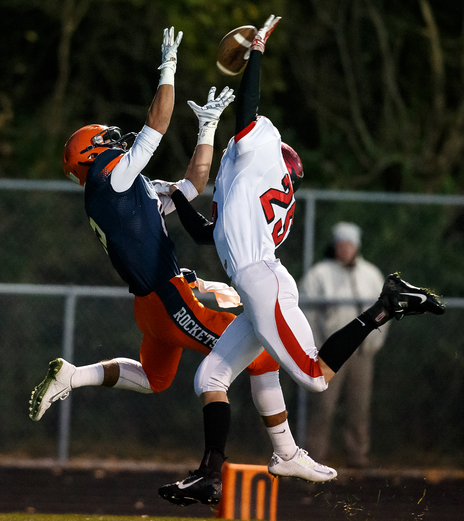 Rochester's Jeremy Bivens (15) pulls in a 28-yard pass over Mt. Zion's Josh Carnahan (25) at the one yard line to set up a touchdown on the next play in the first half during the first round of the Class 4A playoffs at Rocket Booster Field, Saturday, Nov. 1, 2014, in Rochester, Ill. Justin L. Fowler/The State Journal-Register