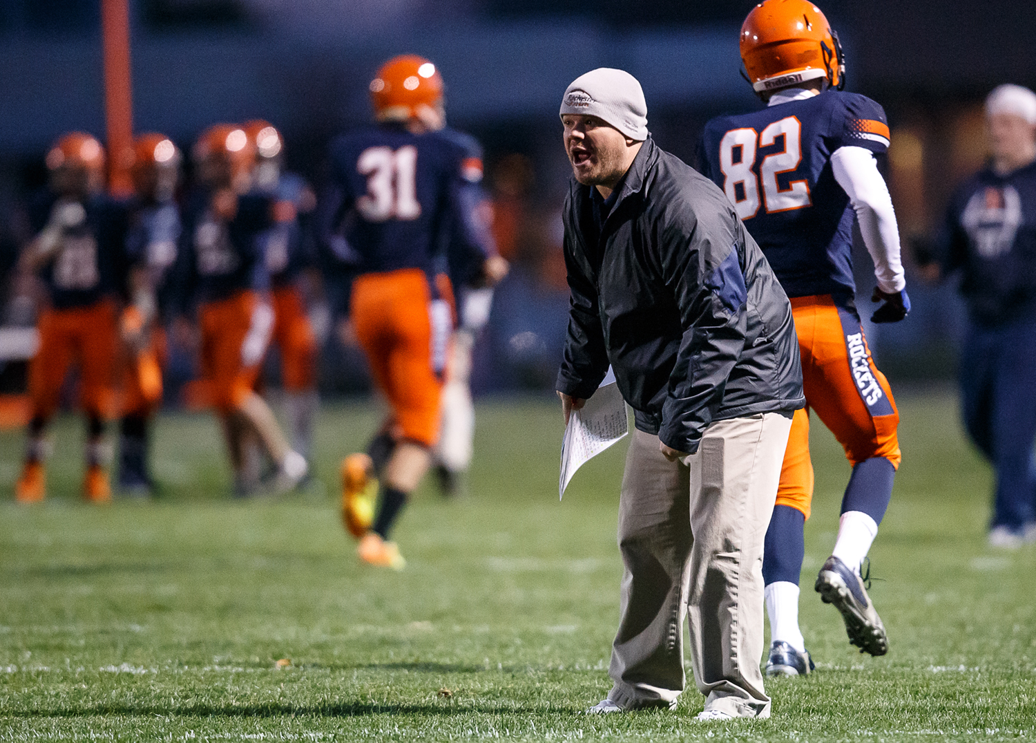 Rochester head football coach Derek Leonard calls out instructions to his players as they take on Mt. Zion in the first half during the first round of the Class 4A playoffs at Rocket Booster Field, Saturday, Nov. 1, 2014, in Rochester, Ill. Justin L. Fowler/The State Journal-Register