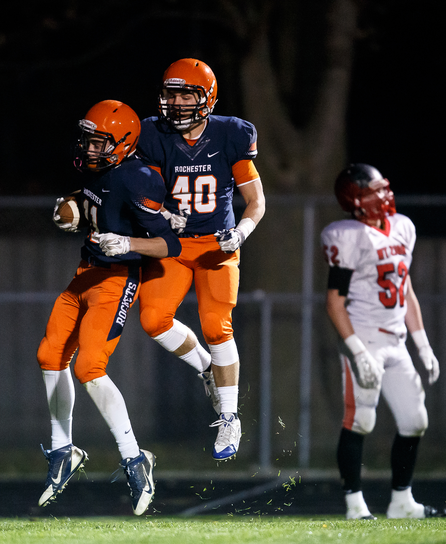 Rochester's Collin Etherton (11) celebrates his touchdown with Colten Shadis (40) as the Rockets take on Mt. Zion in the first half during the first round of the Class 4A playoffs at Rocket Booster Field, Saturday, Nov. 1, 2014, in Rochester, Ill. Justin L. Fowler/The State Journal-Register