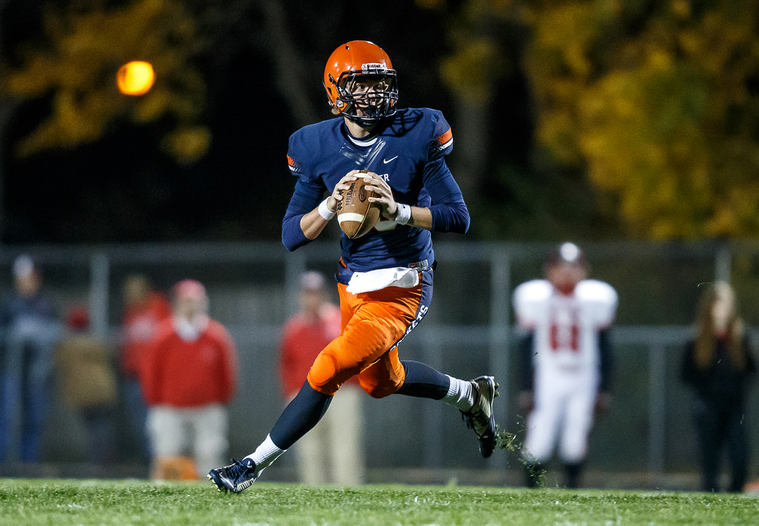 Rochester's Danny Zeigler (10) rolls out of the pocket as he looks for an open receiver against Mt. Zion in the first half during the first round of the Class 4A playoffs at Rocket Booster Field, Saturday, Nov. 1, 2014, in Rochester, Ill. Justin L. Fowler/The State Journal-Register