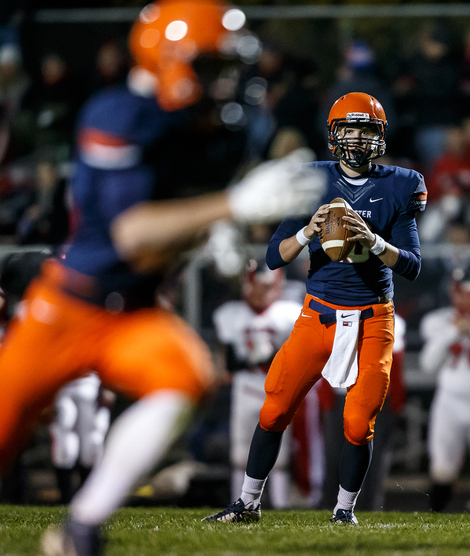 Rochester's Danny Zeigler (10) drops back for a pass against Mt. Zion in the first half during the first round of the Class 4A playoffs at Rocket Booster Field, Saturday, Nov. 1, 2014, in Rochester, Ill. Justin L. Fowler/The State Journal-Register