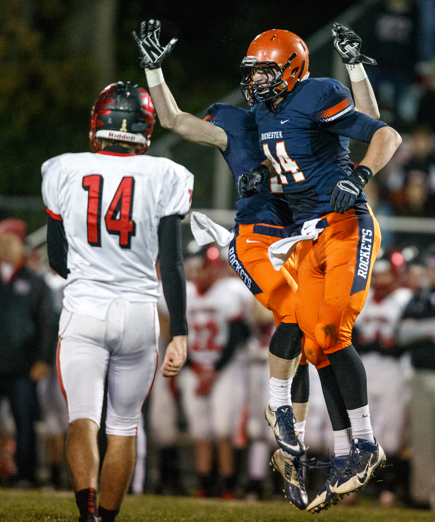 Rochester's Adam Conrady (44) and Dallas Greer (7) celebrate after a pass from Mt. Zion quarterback Payton Grinestaff (14) is knocked down in the first half during the first round of the Class 4A playoffs at Rocket Booster Field, Saturday, Nov. 1, 2014, in Rochester, Ill.   Justin L. Fowler/The State Journal-Register