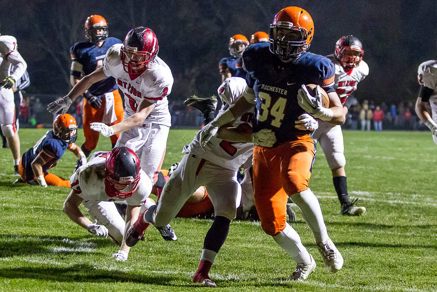 Rochester's Evan Sembell (34) breaks a tackle from Mt. Zion's Charles Kuhle (2) for a touchdown in the first half during the first round of the Class 4A playoffs at Rocket Booster Field, Saturday, Nov. 1, 2014, in Rochester, Ill. Justin L. Fowler/The State Journal-Register