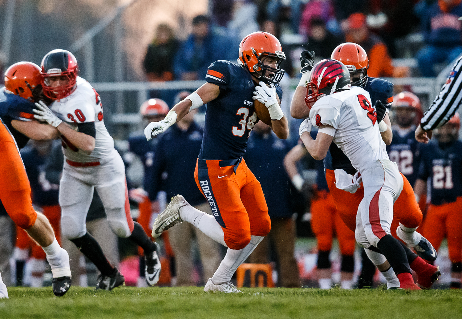 Rochester's Evan Sembell (34) bursts through a hole in the Mt. Zion defense on a rush in the first half during the first round of the Class 4A playoffs at Rocket Booster Field, Saturday, Nov. 1, 2014, in Rochester, Ill. Justin L. Fowler/The State Journal-Register