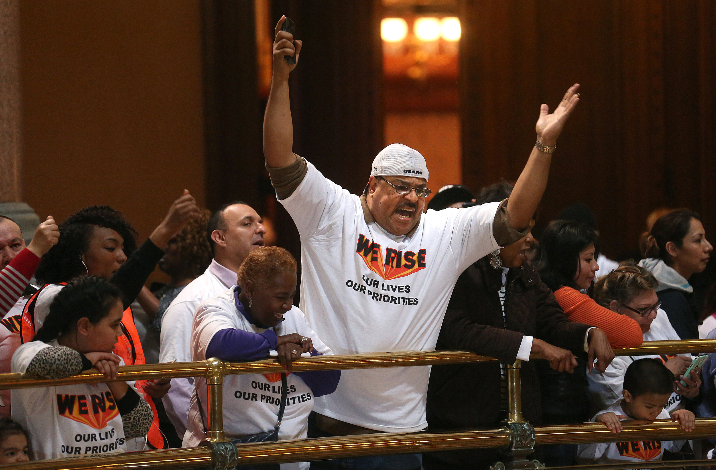 """Protestors gathered on several levels in the rotunda area of the State Capitol building during the rally on Wed. March 11, 2015. As part of """"We Rise"""", a national day of action targeting state budget cuts, several thousand people from faith, community and labor organizations including adults, children and clergy affected by Gov. Bruce Rauner's proposed cuts gathered in Springfield to protest. The event began with a rally inside the Capitol building followed by a march to the governor's mansion where a mock """"funeral"""" for the """"99%"""" took place. David Spencer/The State Journal-Register"""