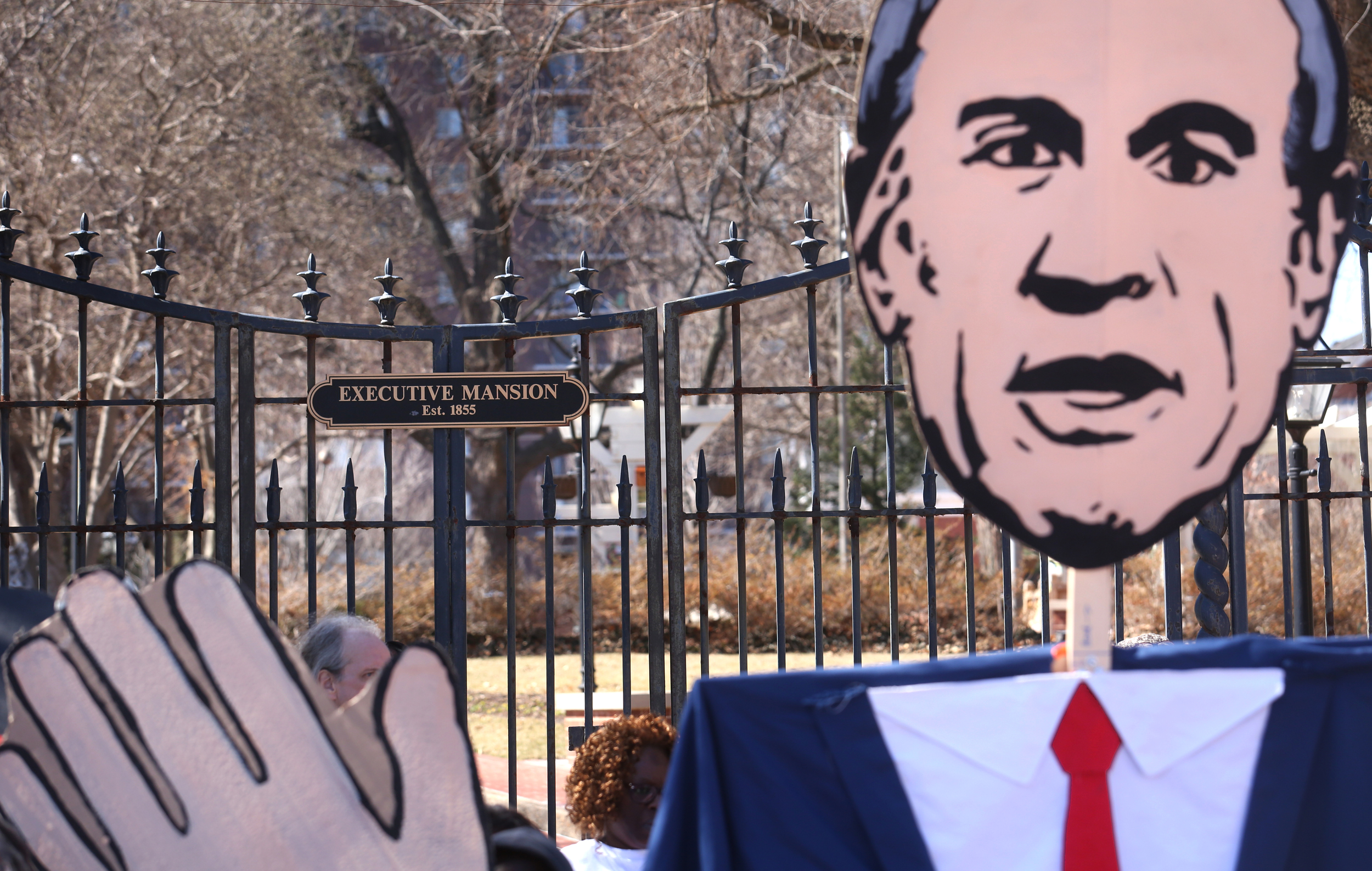 """A large caricature of Gov. Bruce Rauner is held by protestors during a rally and """"funeral"""" at the east gate entrance to the Governor's Mansion in Springfield on Wed. March 11, 2015. As part of """"We Rise"""", a national day of action targeting state budget cuts, several thousand people from faith, community and labor organizations including adults, children and clergy affected by Gov. Bruce Rauner's proposed cuts gathered in Springfield to protest. The event began with a rally inside the Capitol building followed by a march to the governor's mansion where a mock """"funeral"""" for the """"99%"""" took place. David Spencer/The State Journal-Register"""