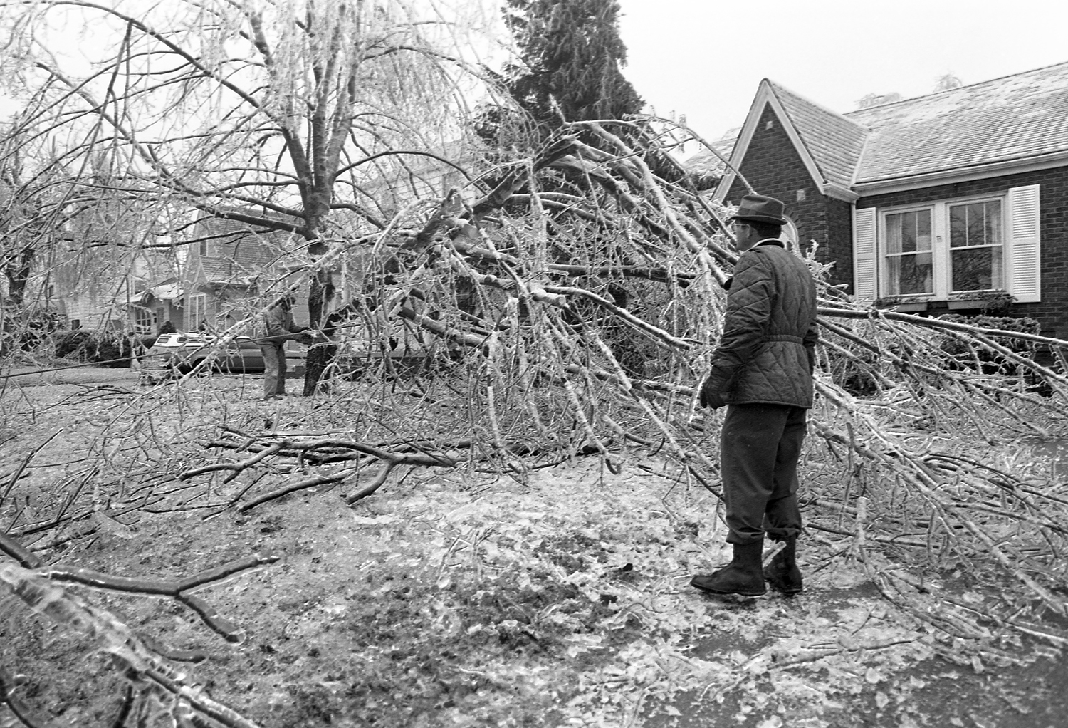 Cleaning up a downed tree at 1055 Bryn Marr Blvd., March 1978.