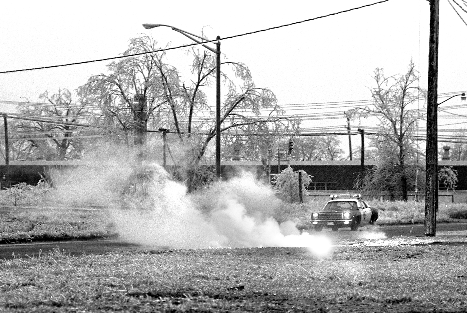 An arcing power line lies on the ground in the 2000 block of East Adams Street.