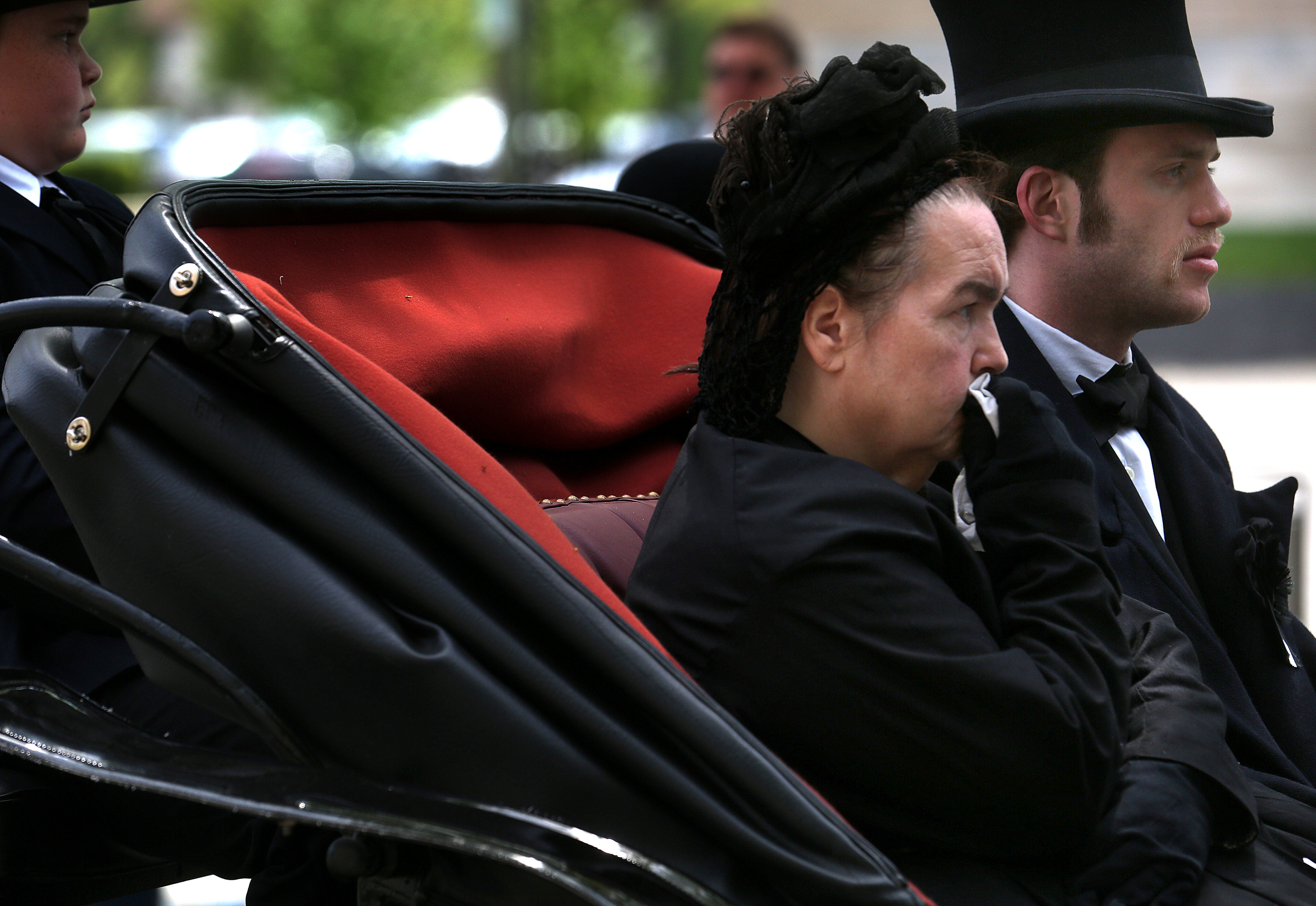 Family members and friends of the Lincoln family rode in a horse-drawn carriage during the funeral procession. David Spencer/The State Journal-Register