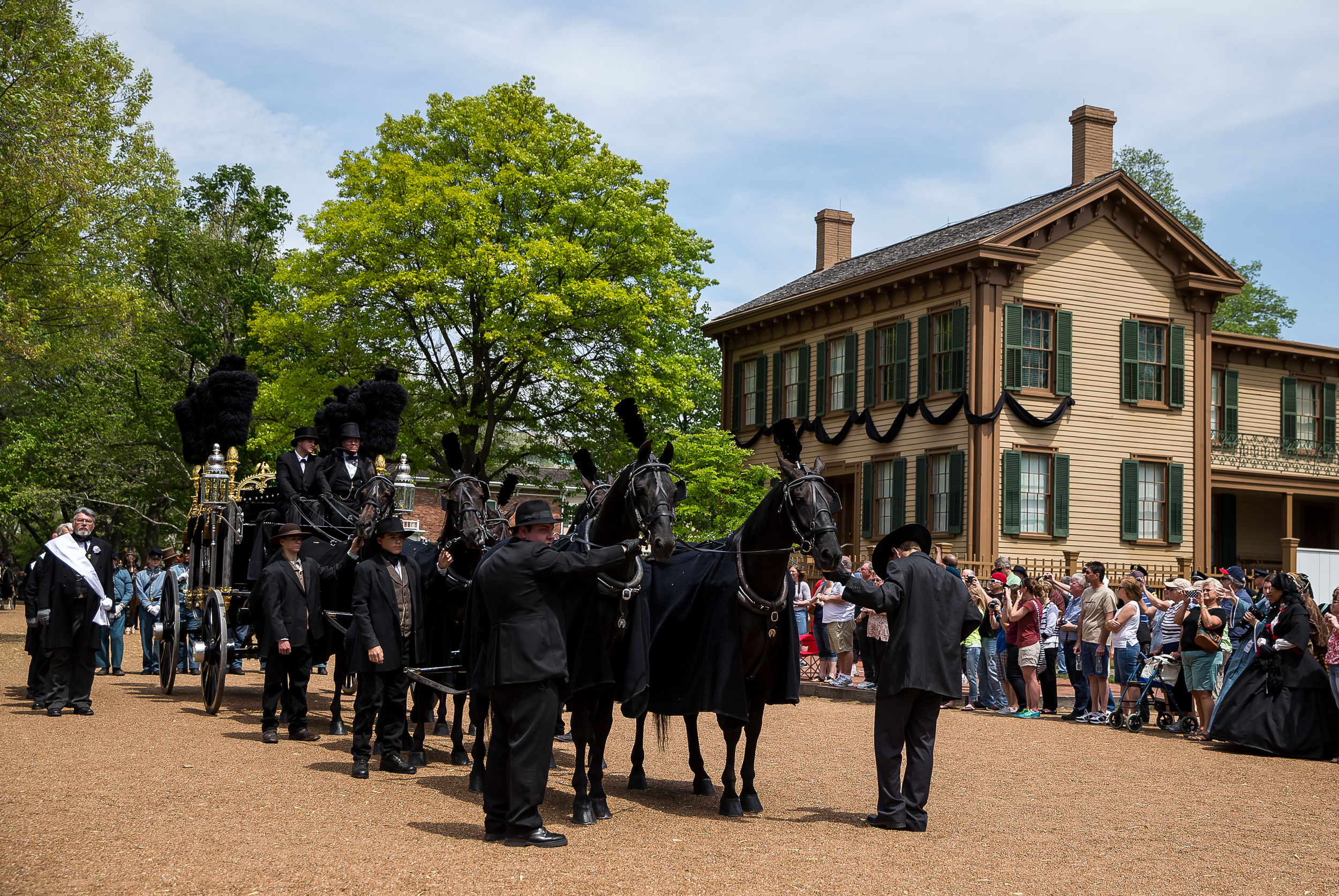 The replica of the horse drawn hearse carrying Lincoln's casket passes by the Lincoln Home during the funeral procession for the 2015 Lincoln Funeral Re-enactment, Sunday, May 3, 2015, in Springfield, Ill. Justin L. Fowler/The State Journal-Register