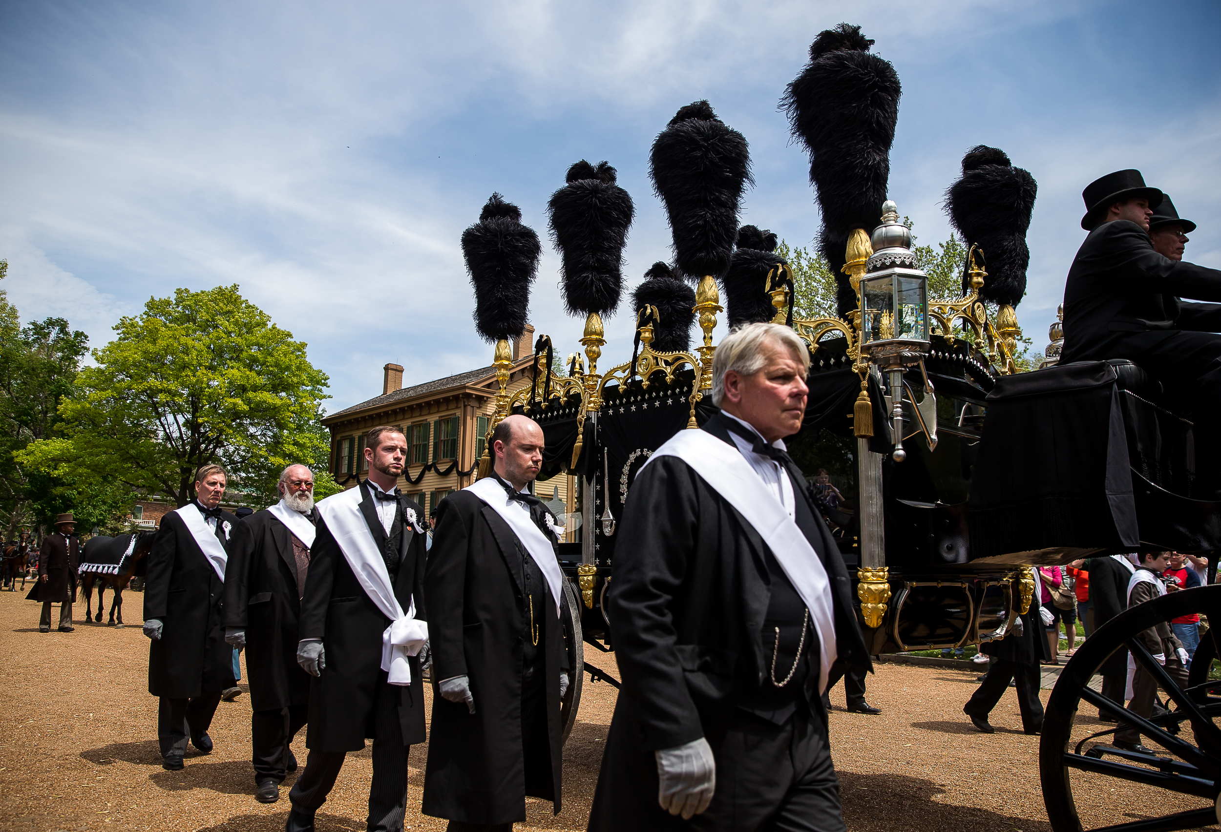 The pallbearers march alongside the ostrich feather topped replica of Lincoln's hearse during the funeral procession for 2015 Lincoln Funeral Re-enactment, Sunday, May 3, 2015, in Springfield, Ill. Justin L. Fowler/The State Journal-Register