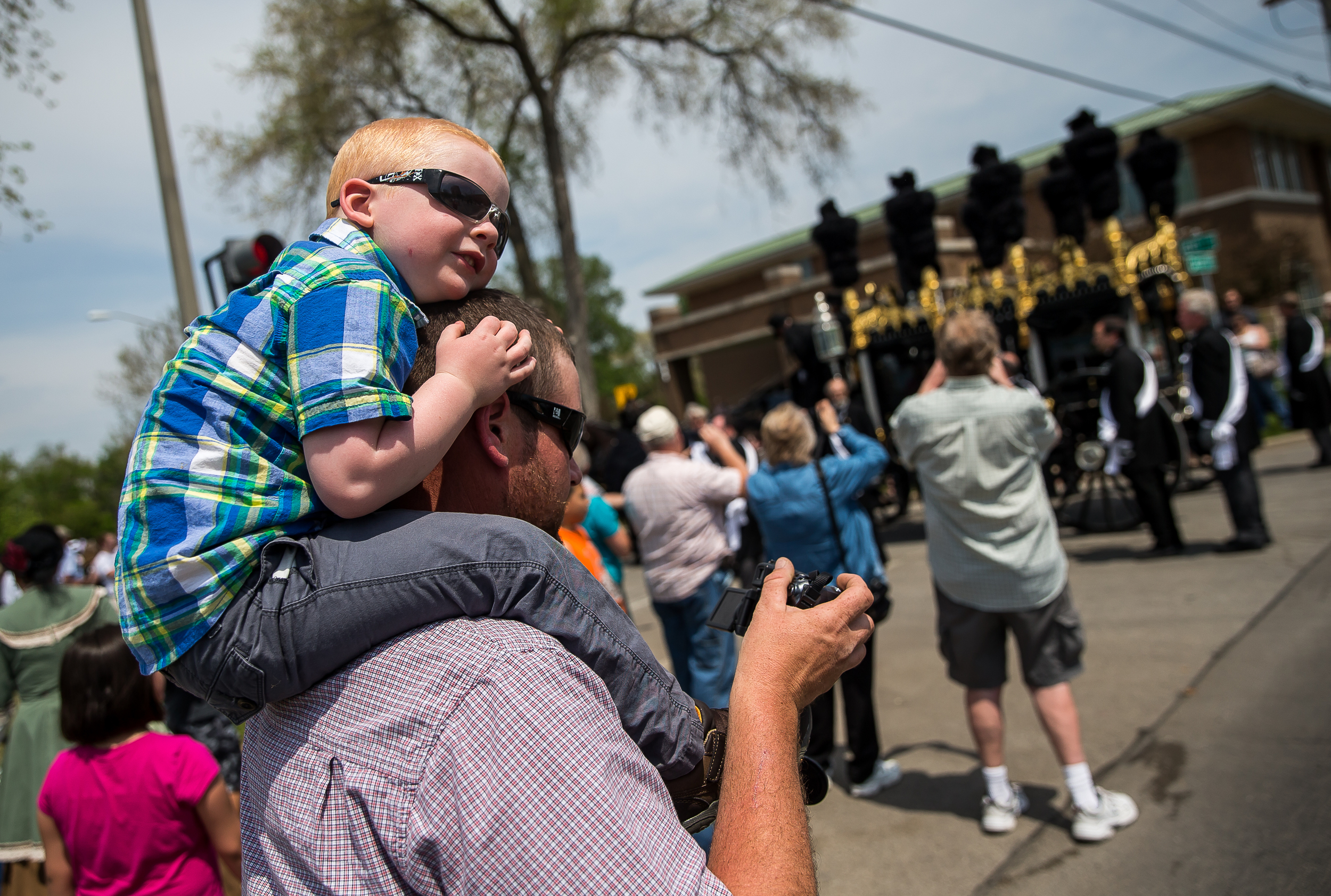 Brody Holmes, 3, watches the Lincoln hearse pass by from the shoulders of his father, Brian, during the funeral procession in the 2015 Lincoln Funeral Re-enactment, Sunday, May 3, 2015, in Springfield, Ill. Justin L. Fowler/The State Journal-Register