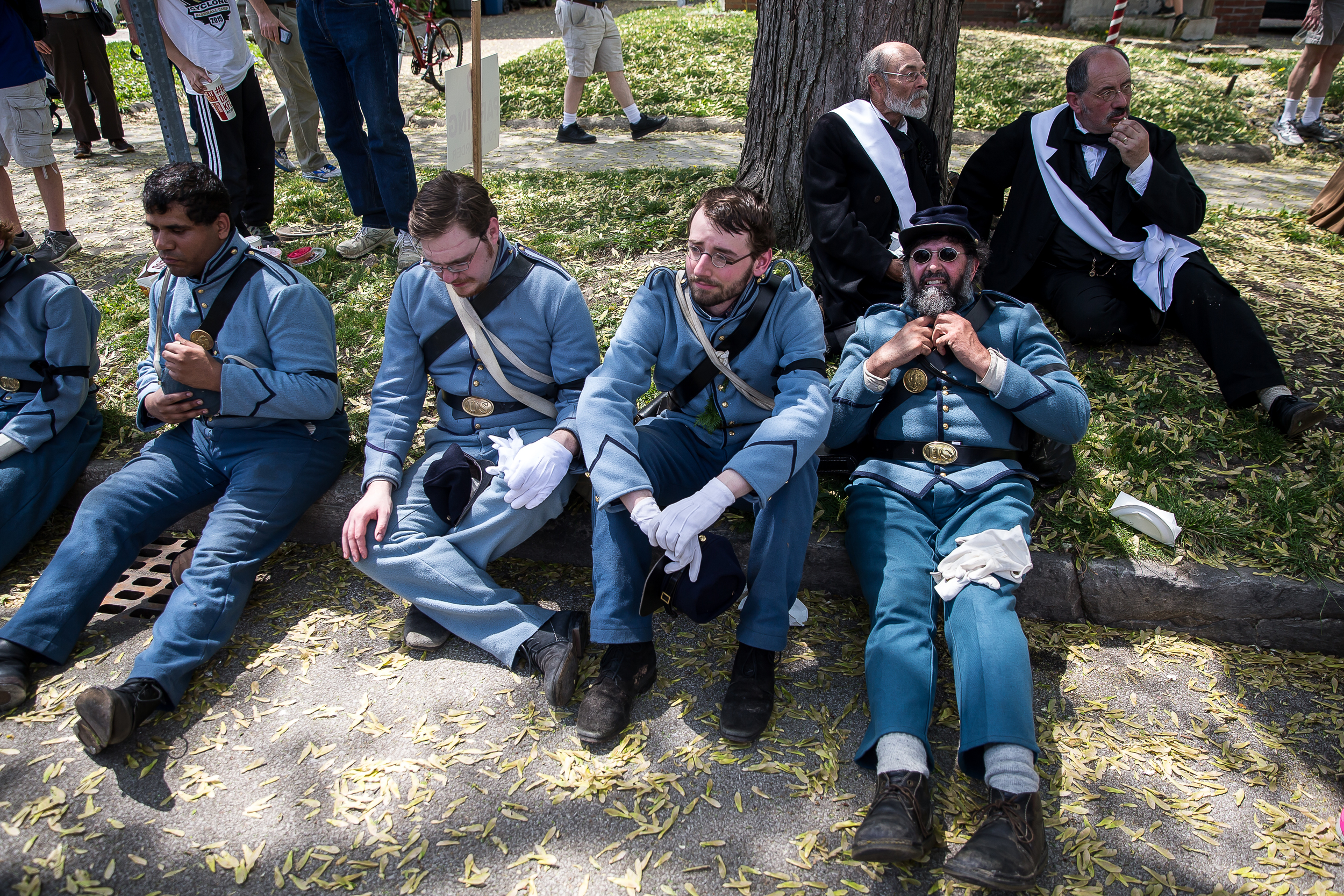 Members of the Veteran Reserve Corps and the pallbearers take a break in the shade as the funeral procession stops for a moment on Fourth Street during the 2015 Lincoln Funeral Re-enactment, Sunday, May 3, 2015, in Springfield, Ill. Justin L. Fowler/The State Journal-Register