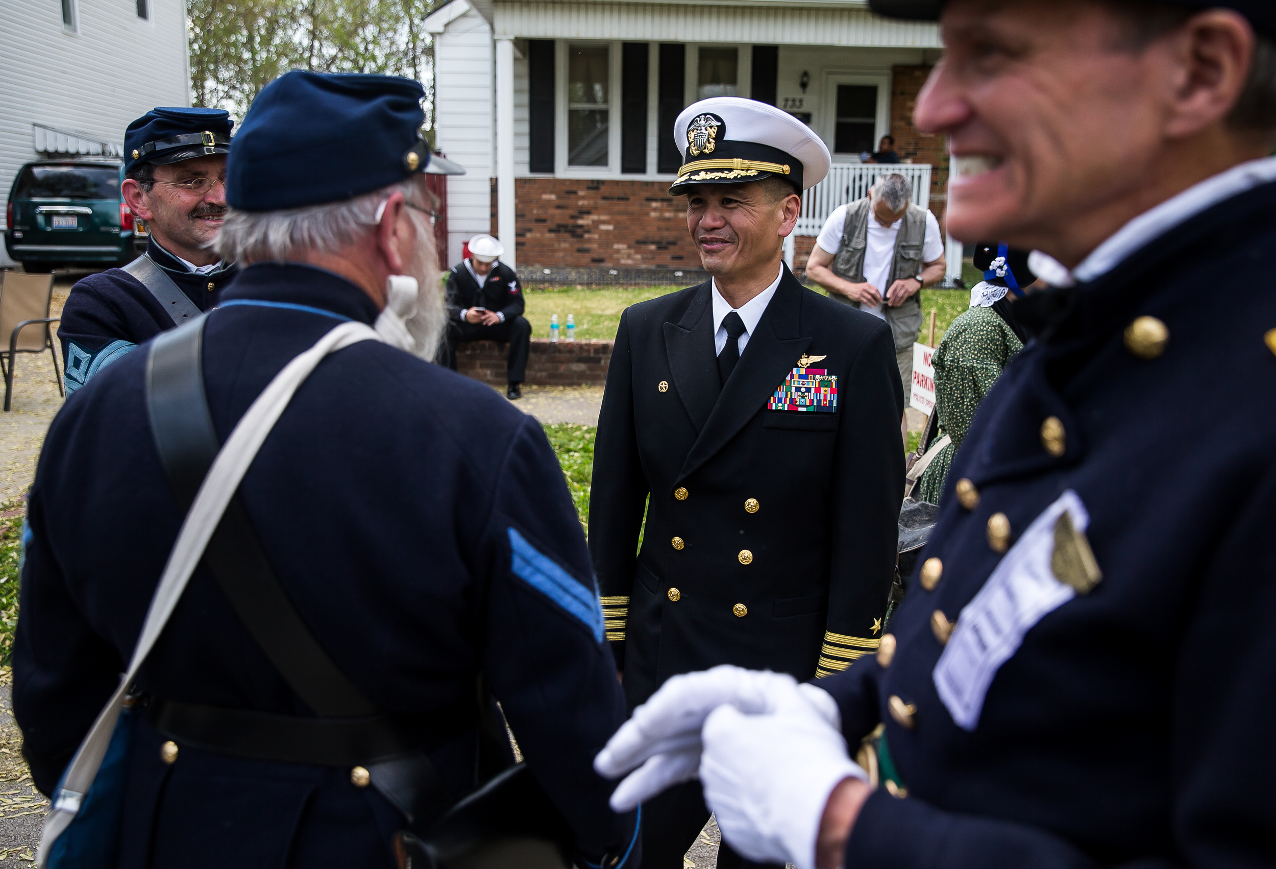 Capt. Ron Ravelo, center, Commanding Officer USS Abraham Lincoln, pauses for a moment to talk with the re-enactors as the funeral procession takes a break along Fourth Street during the 2015 Lincoln Funeral Re-enactment, Sunday, May 3, 2015, in Springfield, Ill. Justin L. Fowler/The State Journal-Register