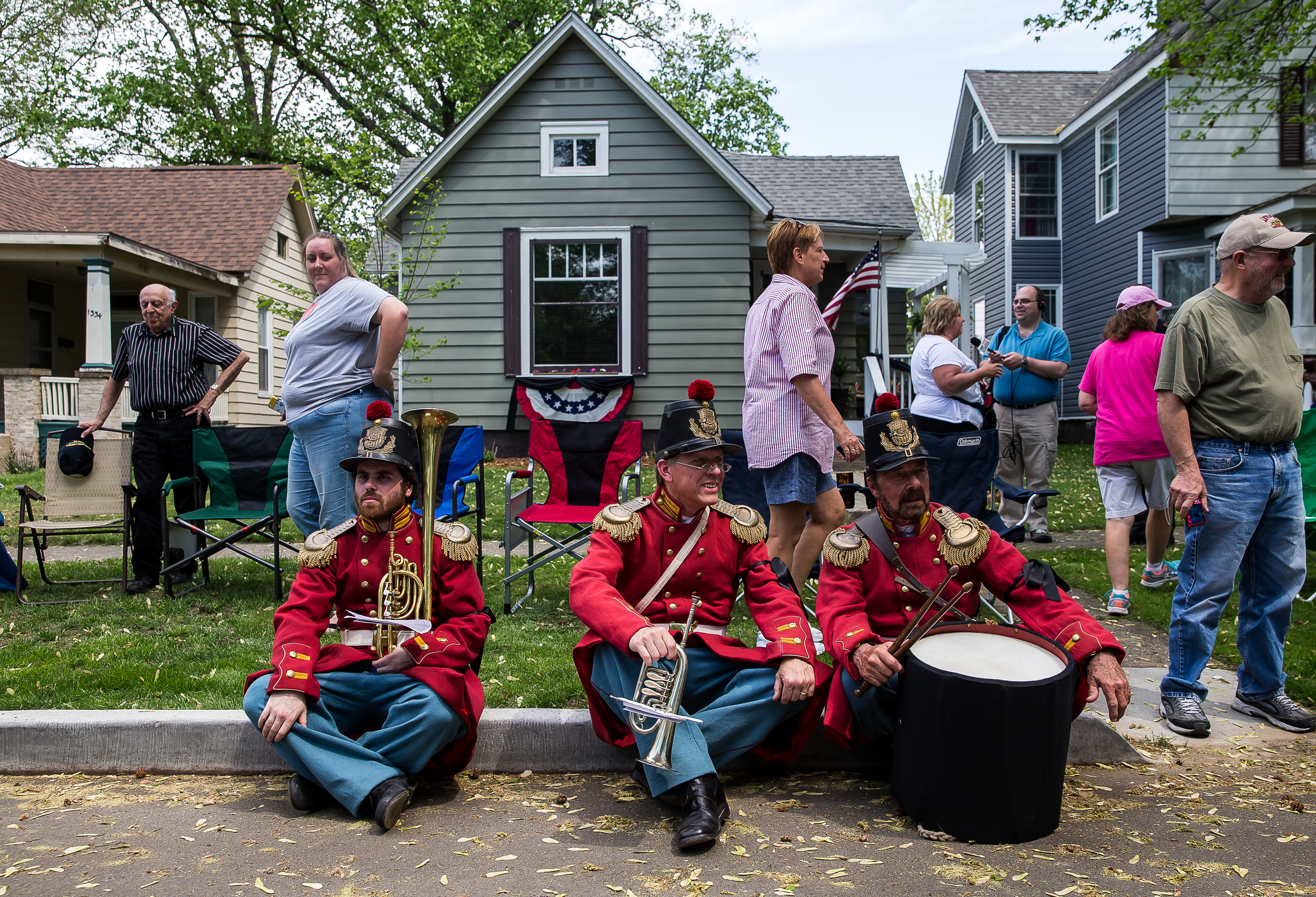 David Jaffe, left, Jeff Stockham, center, and Garman Bowers Jr., right, all members of President Lincoln's Own Band, take a break from the funeral procession during the 2015 Lincoln Funeral Re-enactment, Sunday, May 3, 2015, in Springfield, Ill. The instruments that the band members play are authentic instruments from the time period. Justin L. Fowler/The State Journal-Register