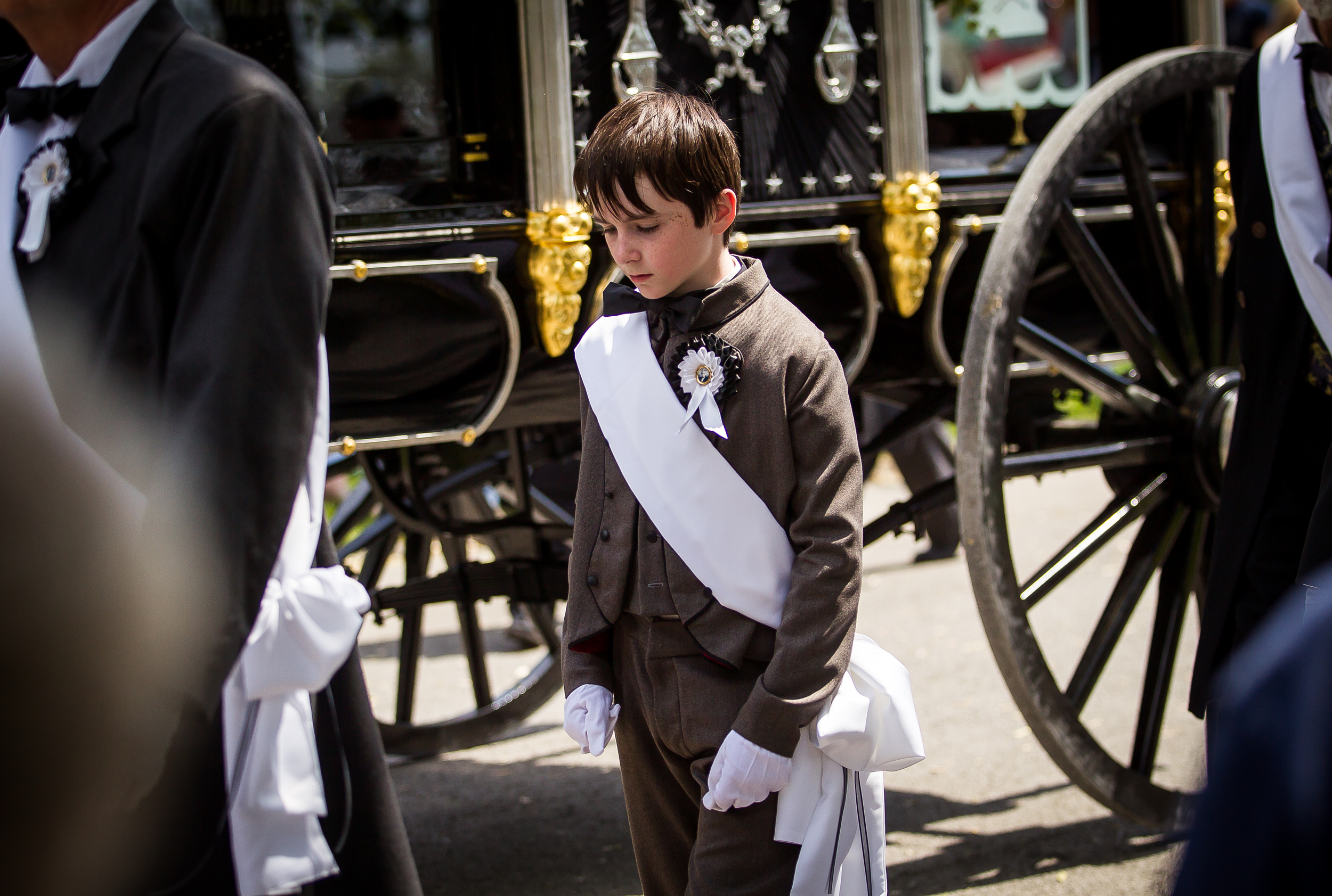 William Polston, 11, of Minneapolis, Minn., serves as a pallbearer walking next the recreation of Lincoln's hearse in the funeral procession during the 2015 Lincoln Funeral Re-enactment, Sunday, May 3, 2015, in Springfield, Ill. Polston is a a descendant of Stephen Trigg Logan, one of the original pallbearers that walked along side Lincoln's hearse. Justin L. Fowler/The State Journal-Register