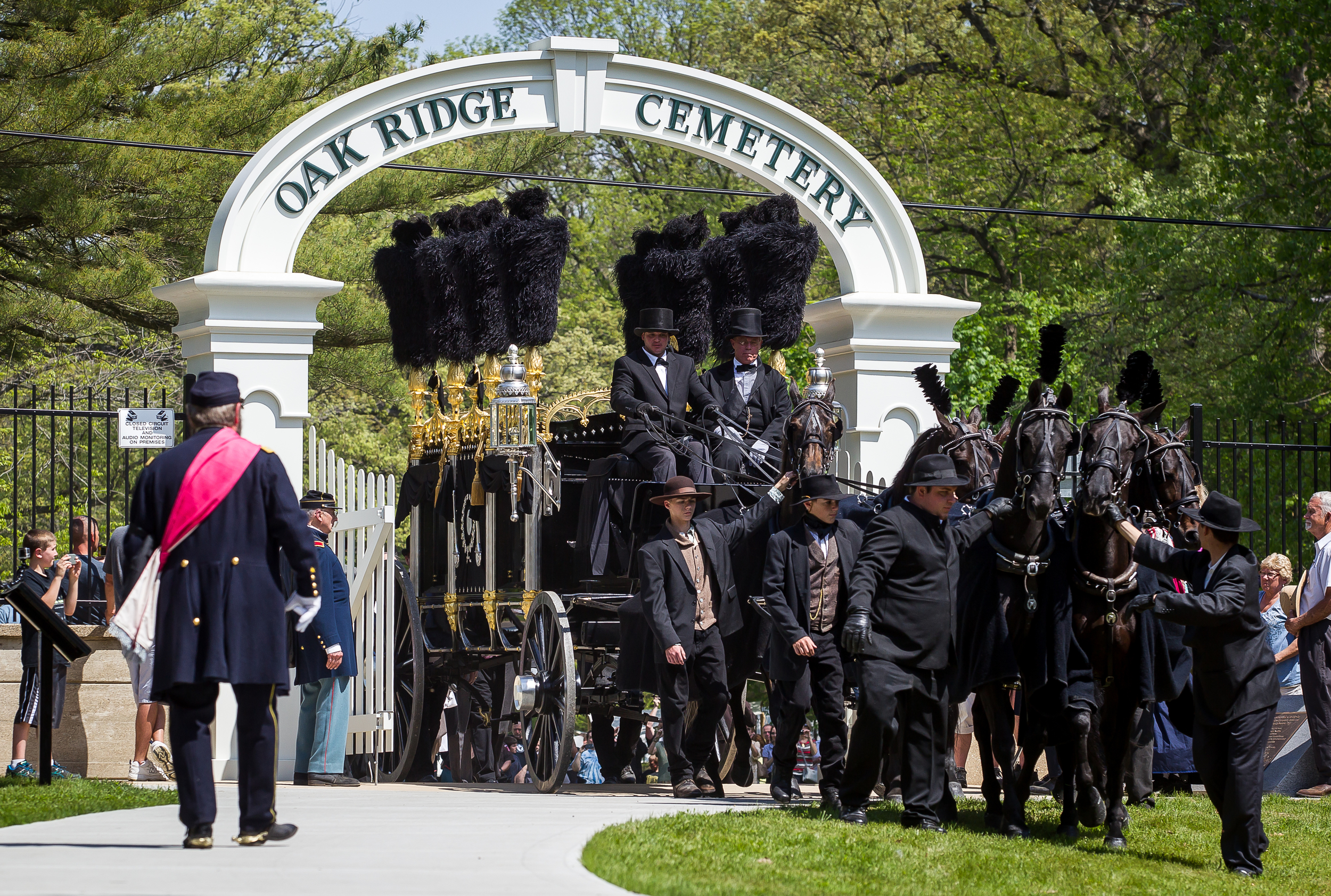 The horse drawn replica of Lincoln's hearse comes through the First Street entrance to Oak Ridge Cemetery to delivery Lincoln's casket to the original receiving vault during the 2015 Lincoln Funeral Re-enactment, Sunday, May 3, 2015, in Springfield, Ill. Justin L. Fowler/The State Journal-Register