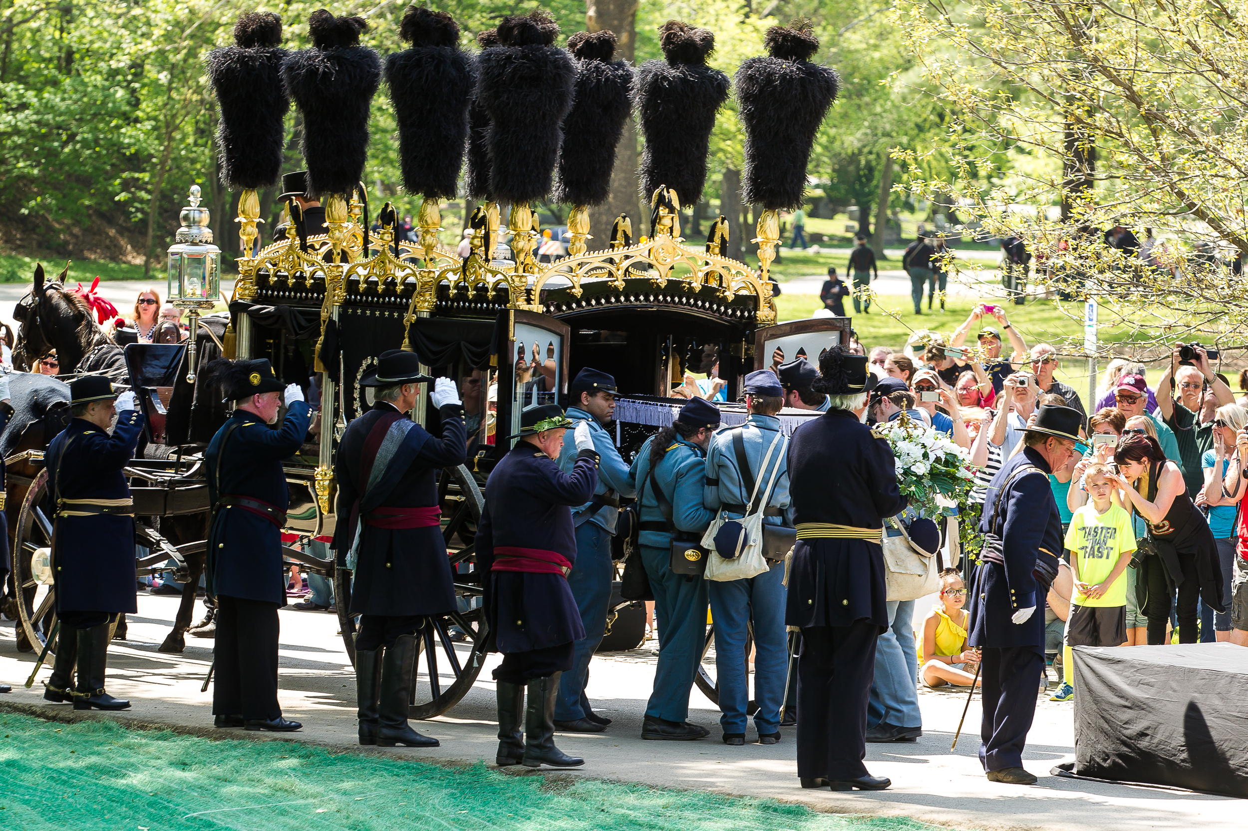 The Veteran Reserve Corps unloads Lincoln's casket from the replica horse drawn hearse in front of the original receiving vault during the 2015 Lincoln Funeral Re-enactment, Sunday, May 3, 2015, in Springfield, Ill. Justin L. Fowler/The State Journal-Register