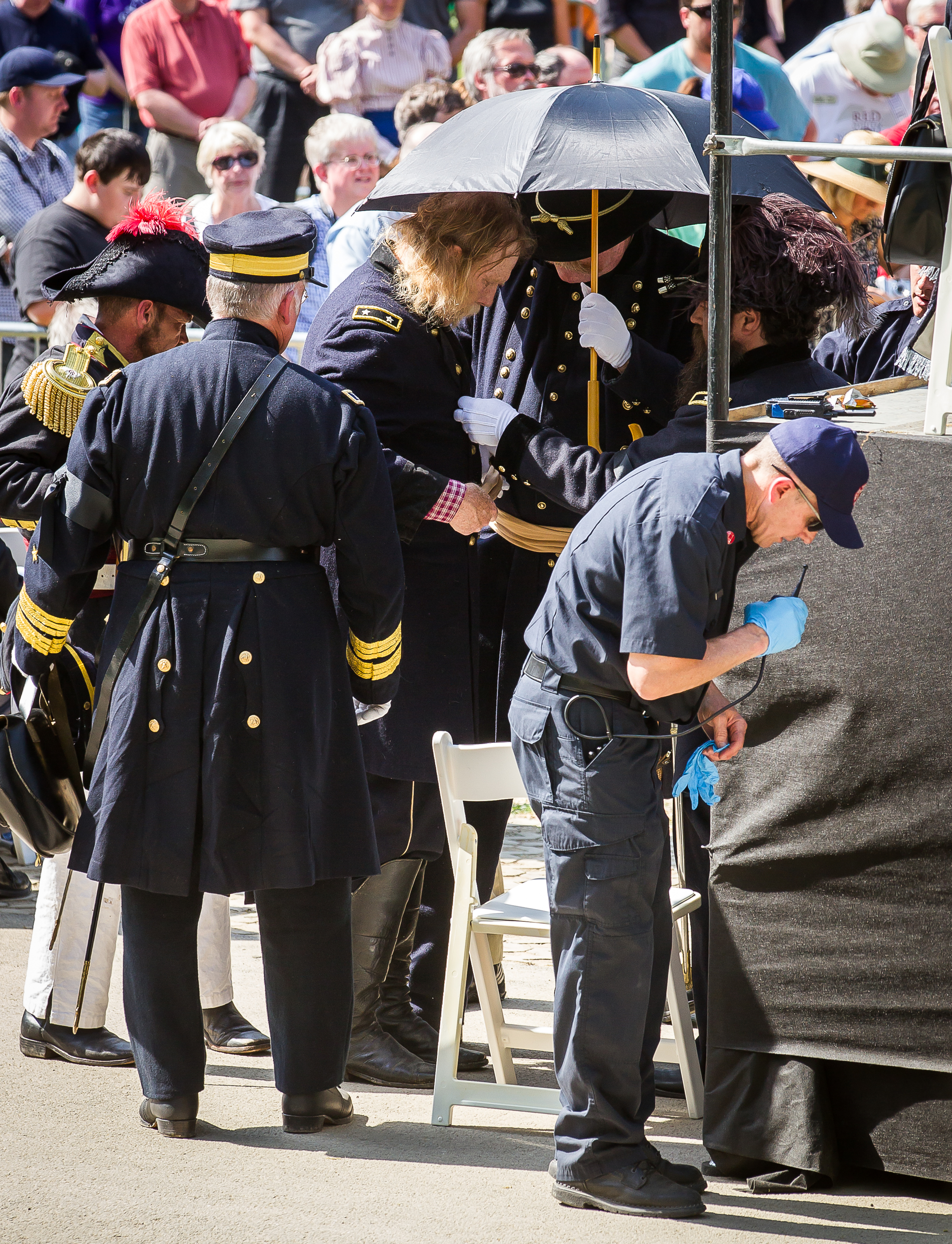 Medical staff come to the aid of a re-enactor overcome by the heat near the original receiving vault during the 2015 Lincoln Funeral Re-enactment, Sunday, May 3, 2015, in Springfield, Ill.  Justin L. Fowler/The State Journal-Register