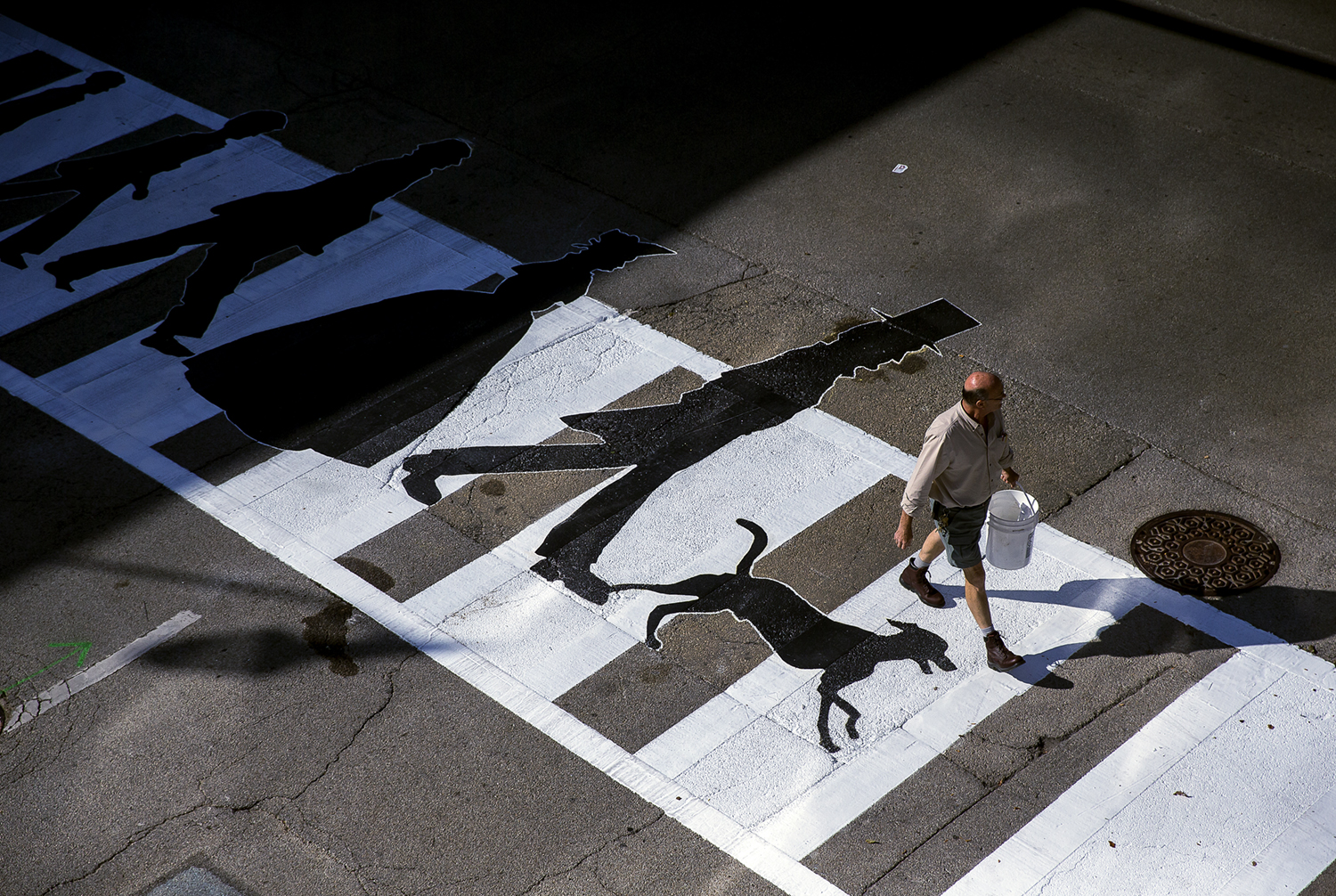 Downtown Springfield Inc. along with the Prairie Art Alliance completed the first creative crosswalk at South 6th Street and East Washington Street that depicts the Lincoln family crossing the intersection. Justin L. Fowler/The State Journal-Register