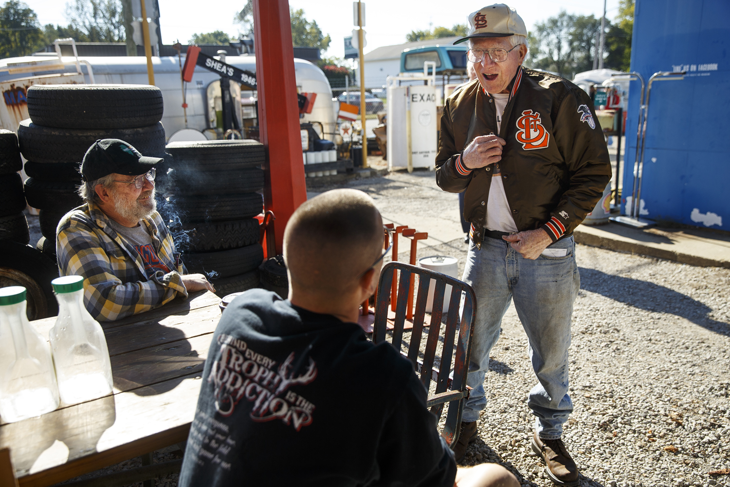 """""""I wouldn't walk across the street to see the Cardinals,"""" Bob McLean scoffed as he showed Jared Baker his St. Louis Browns jacket while visiting at Shea's Gas Station and Museum in Springfield Saturday, Oct. 10, 2015. McLean, and his son John, left, were at Shea's for an auction of some of the contents of Shea's. The Browns moved to Baltimore after the 1953 baseball season. Ted Schurter/The State Journal-Register"""