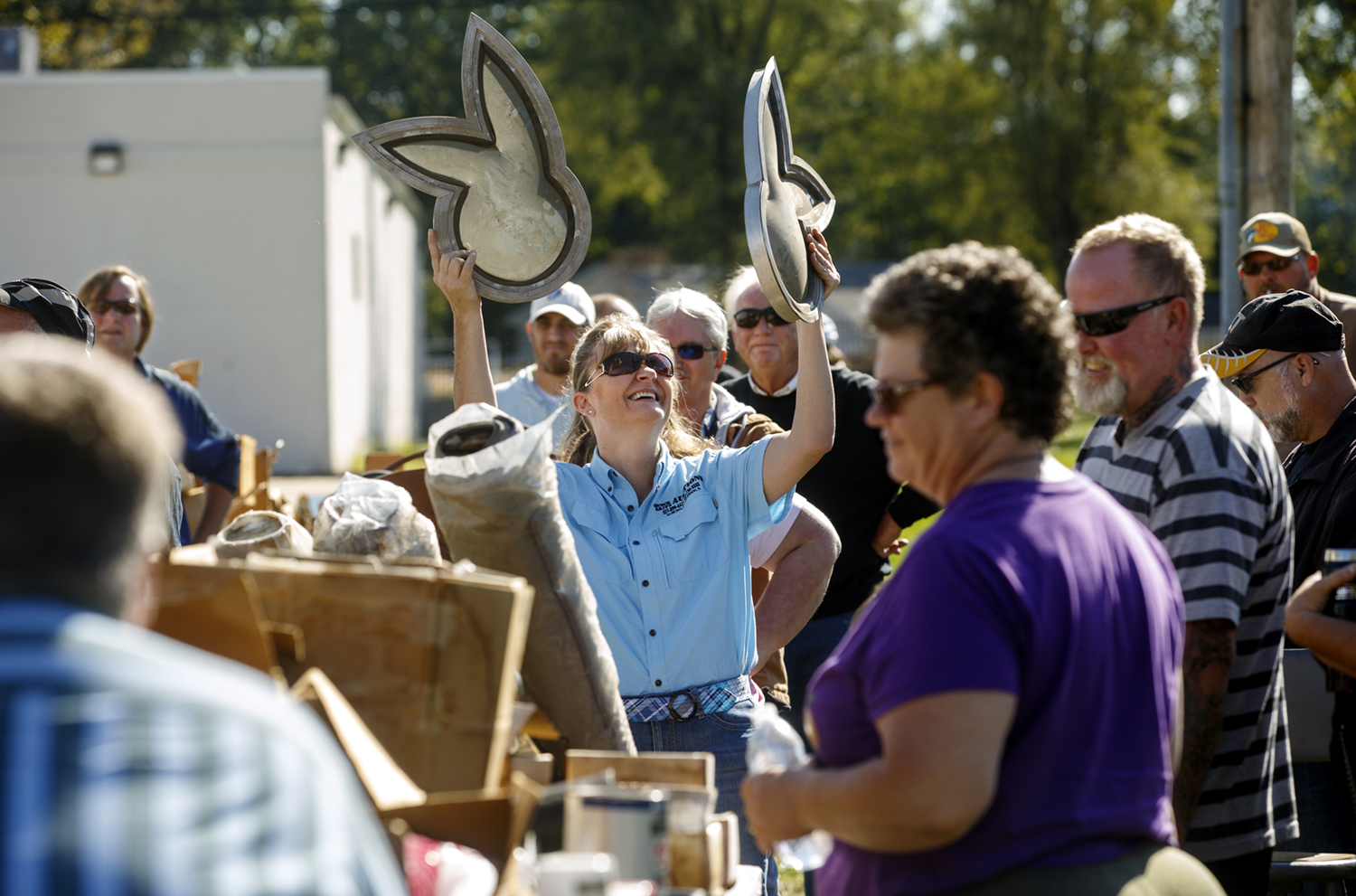 Tammy Covi holds up a pair of ears for sale at Shea's Gas Station and Museum in Springfield Saturday, Oct. 10, 2015. The Route 66 landmark first opened in 1995 at 2075 Peoria Road by Bill Shea, who passed away in December 2013. Ted Schurter/The State Journal-Register