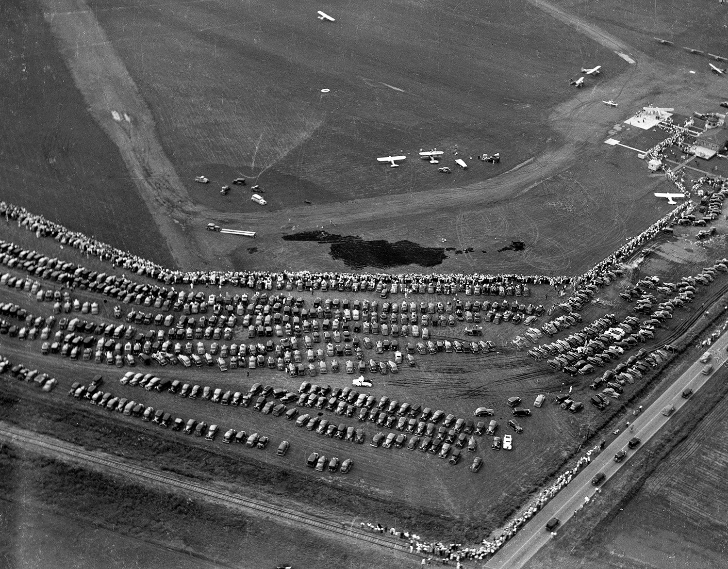 An air show at the municipal airport drew a crowd June 12, 1938. Chatham road is in the lower right corner of the picture. File/The State Journal-Register