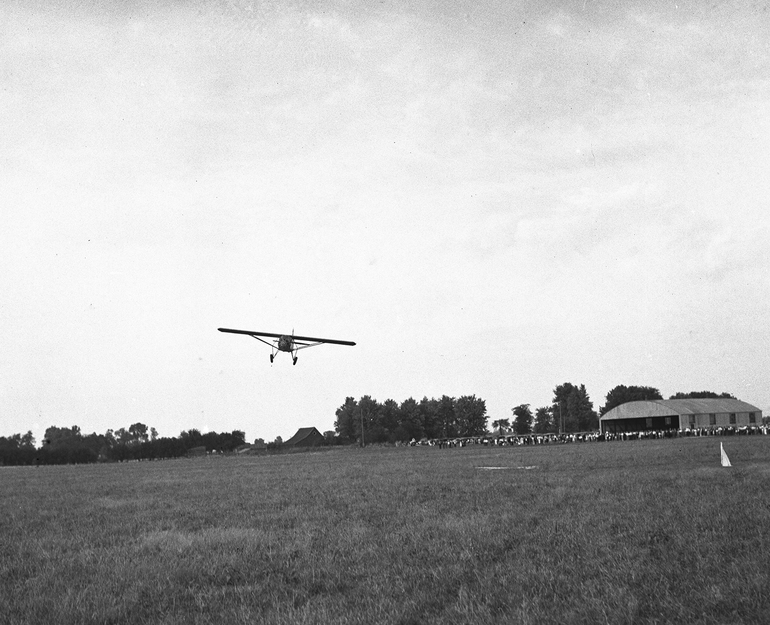 A plane flies over the municipal airport  Oct. 5, 1931. File/The State Journal-Register