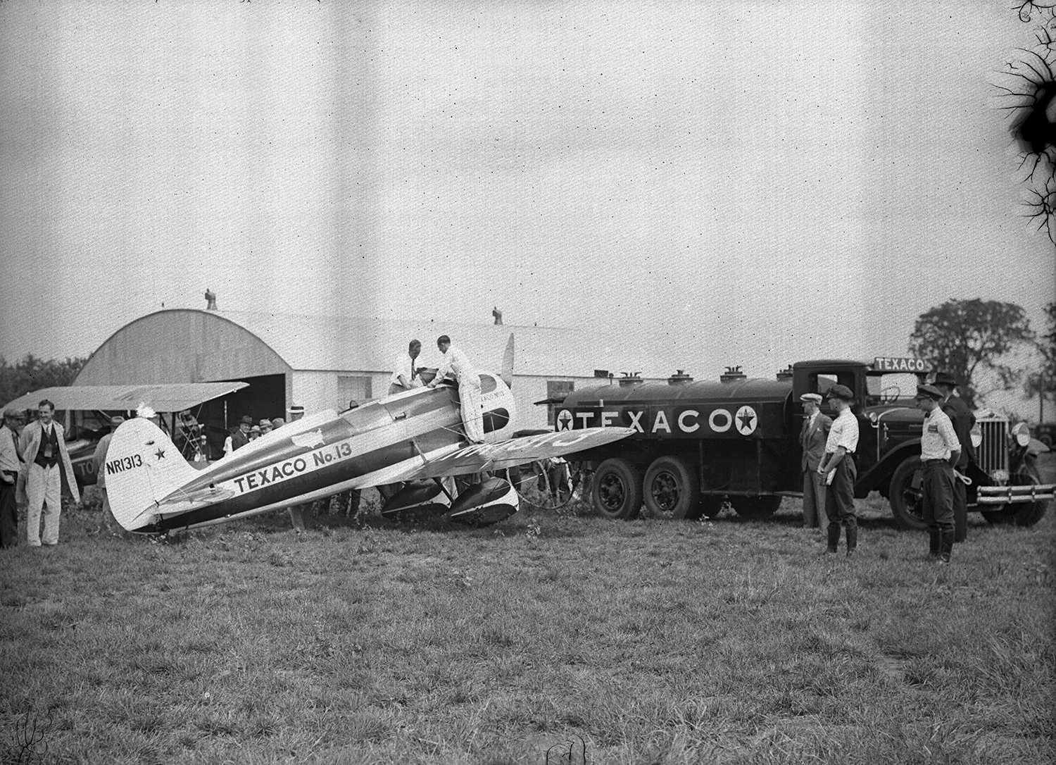 Texaco fuel truck filling airplane at municipal airport, ca. 1929. File/The State Journal-Register