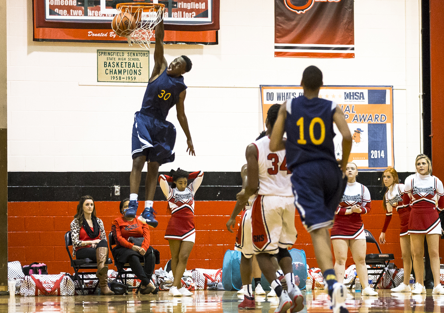 Southeast's D'Angelo Hughes (30) puts down a dunk against Springfield in the second half at Springfield High School, Tuesday, Dec. 8, 2015, in Springfield, Ill. Justin L. Fowler/The State Journal-Register