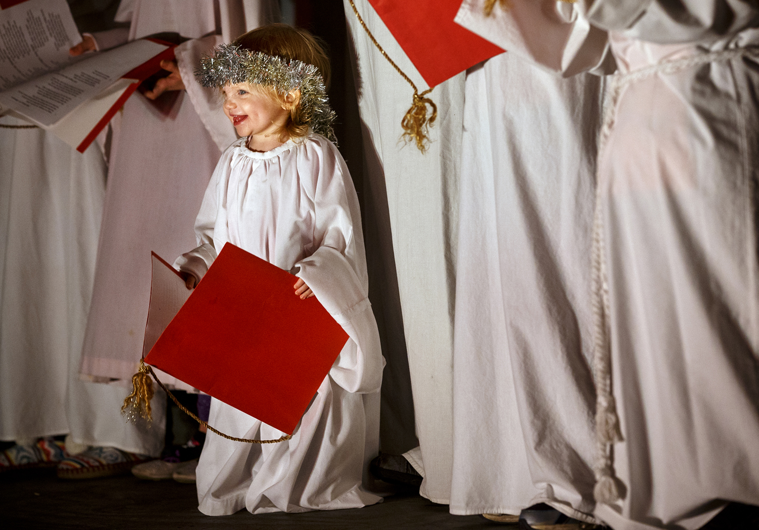 Twenty-two-month-old Sadie Winkelman joined the choir of angels singing at the Our Savior's Lutheran Church and School's annual Live Nativity Friday, Dec. 11, 2015. The free drive-through event features holiday lights, a choir of angels, period-dressed actors, and live animals and continues Saturday, Dec. 12 from 7-9 p.m. Ted Schurter/The State Journal-Register